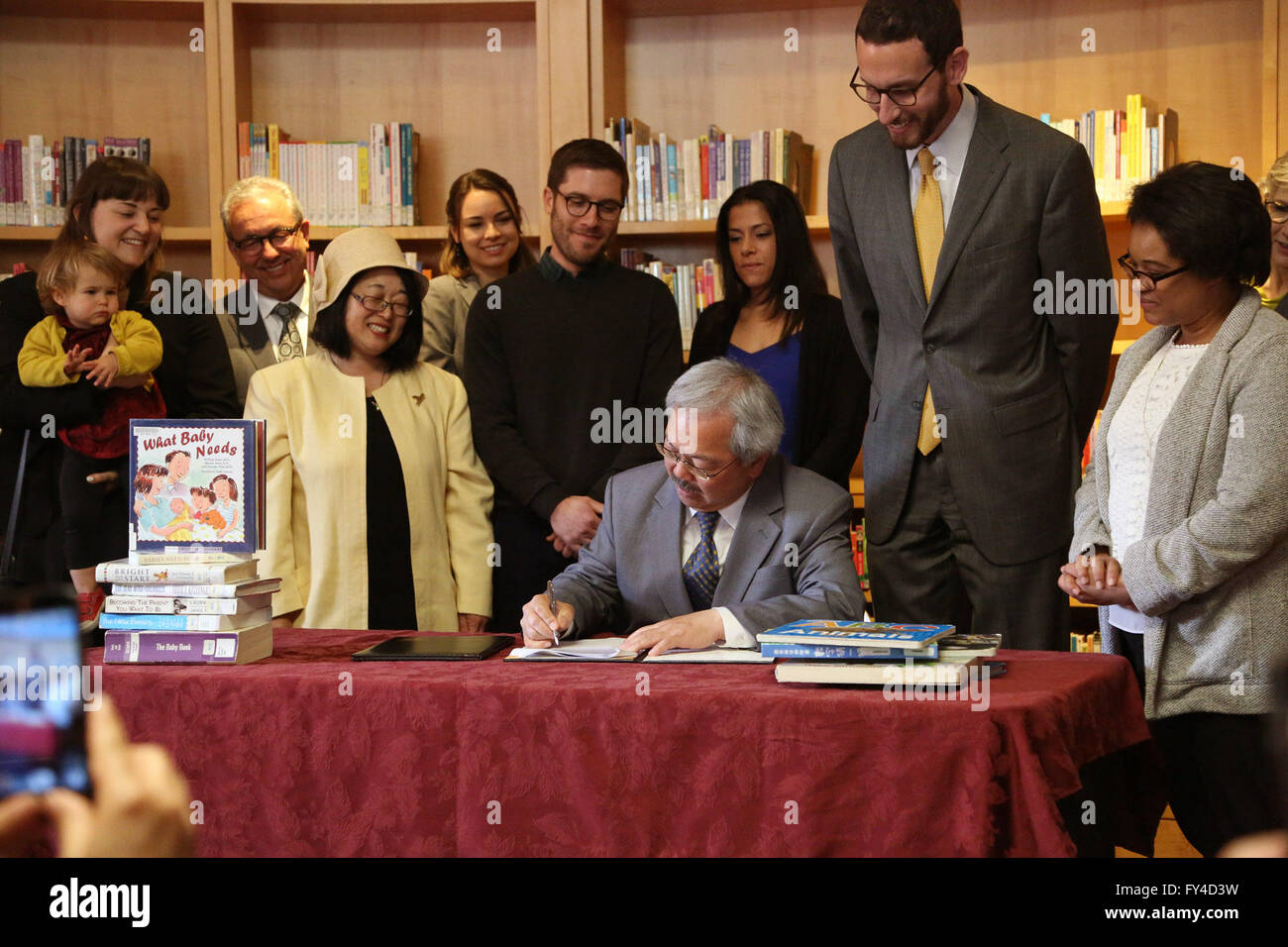 San Francisco, USA. 21st Apr, 2016. San Francisco Mayor Ed Lee signs a fully paid parental leave ordinance at the - Stock Image