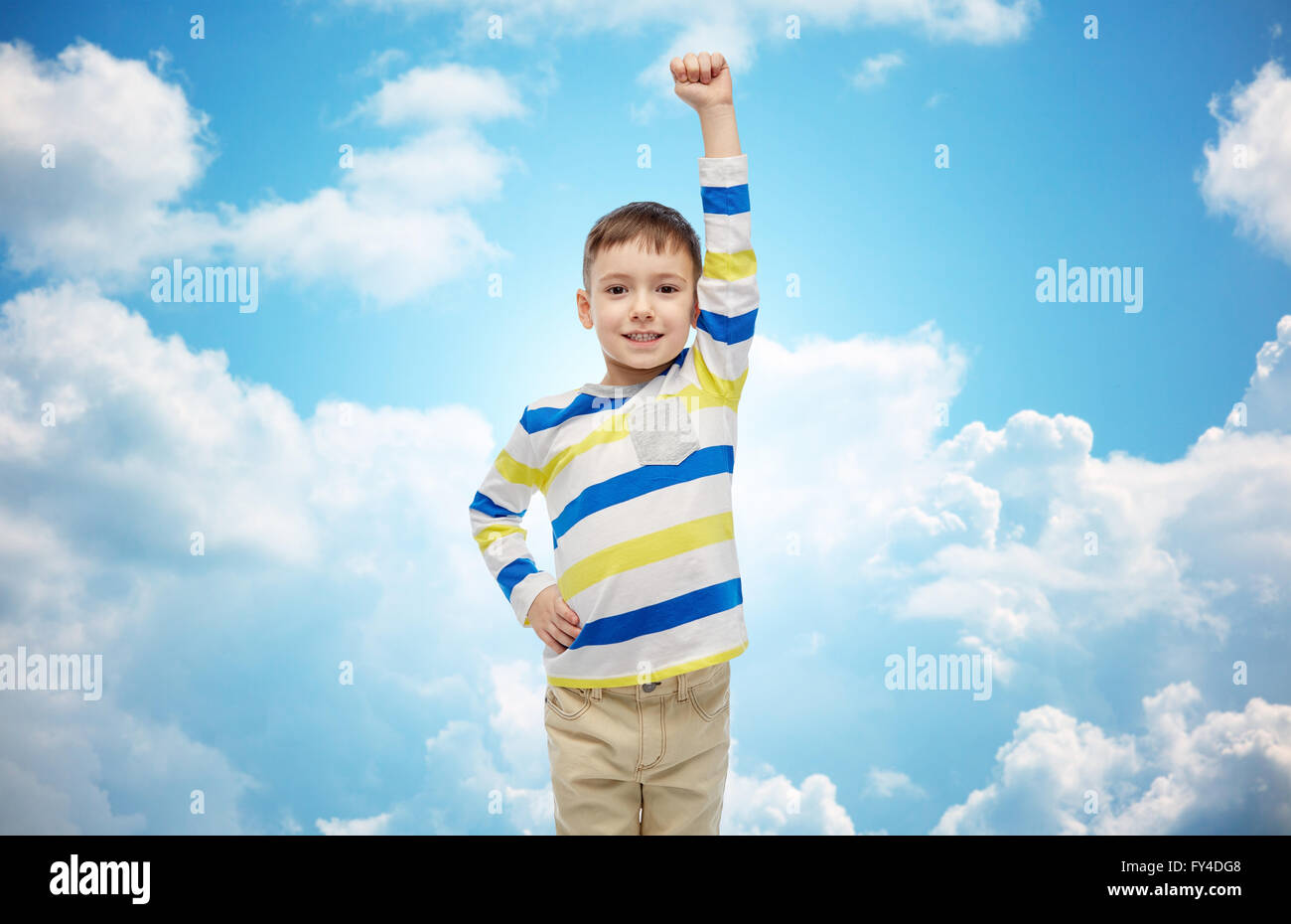 6978a0a7108ad happy smiling little boy with raised hand Stock Photo: 102746008 - Alamy