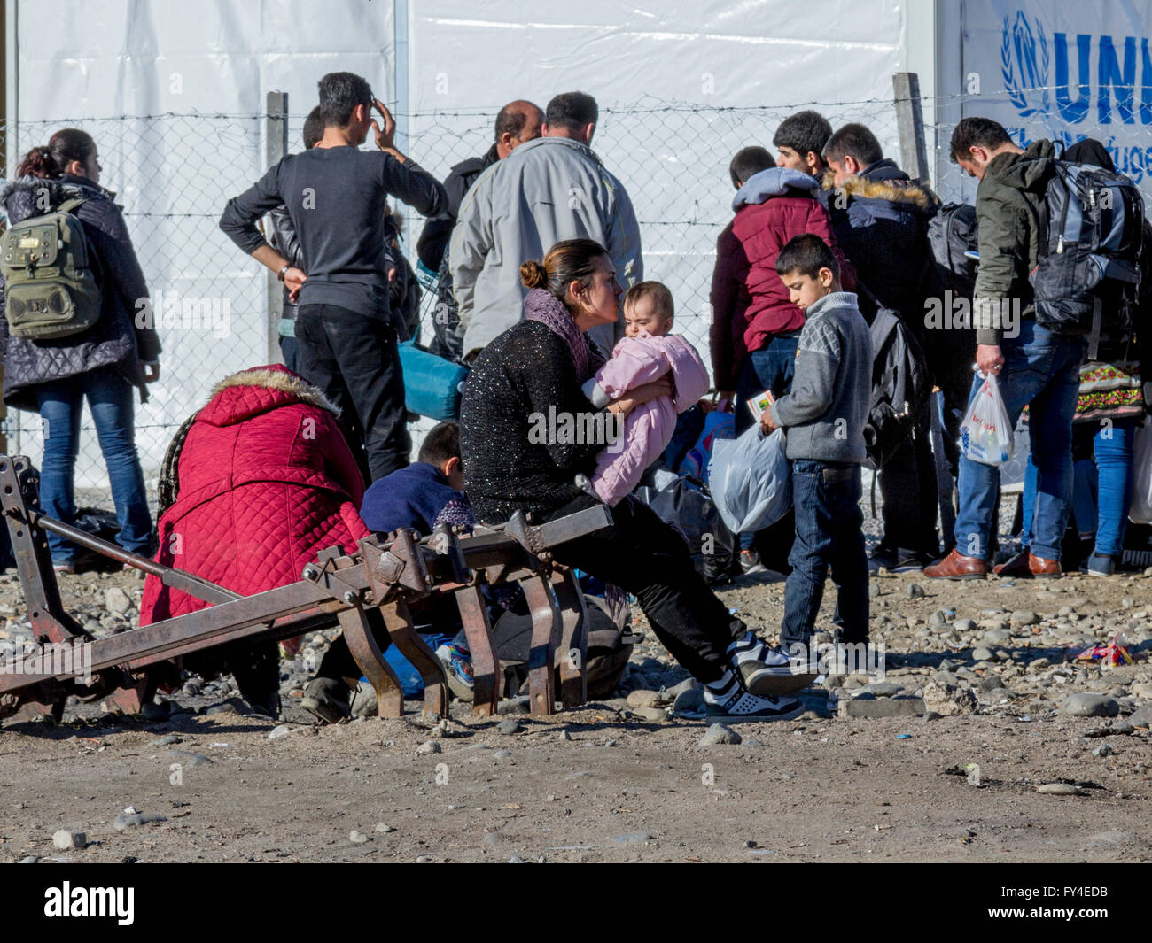 Refugees waiting to register in the refugee camp of Gevgelija after having crossed the border with Greece in Idomeni - Stock Image