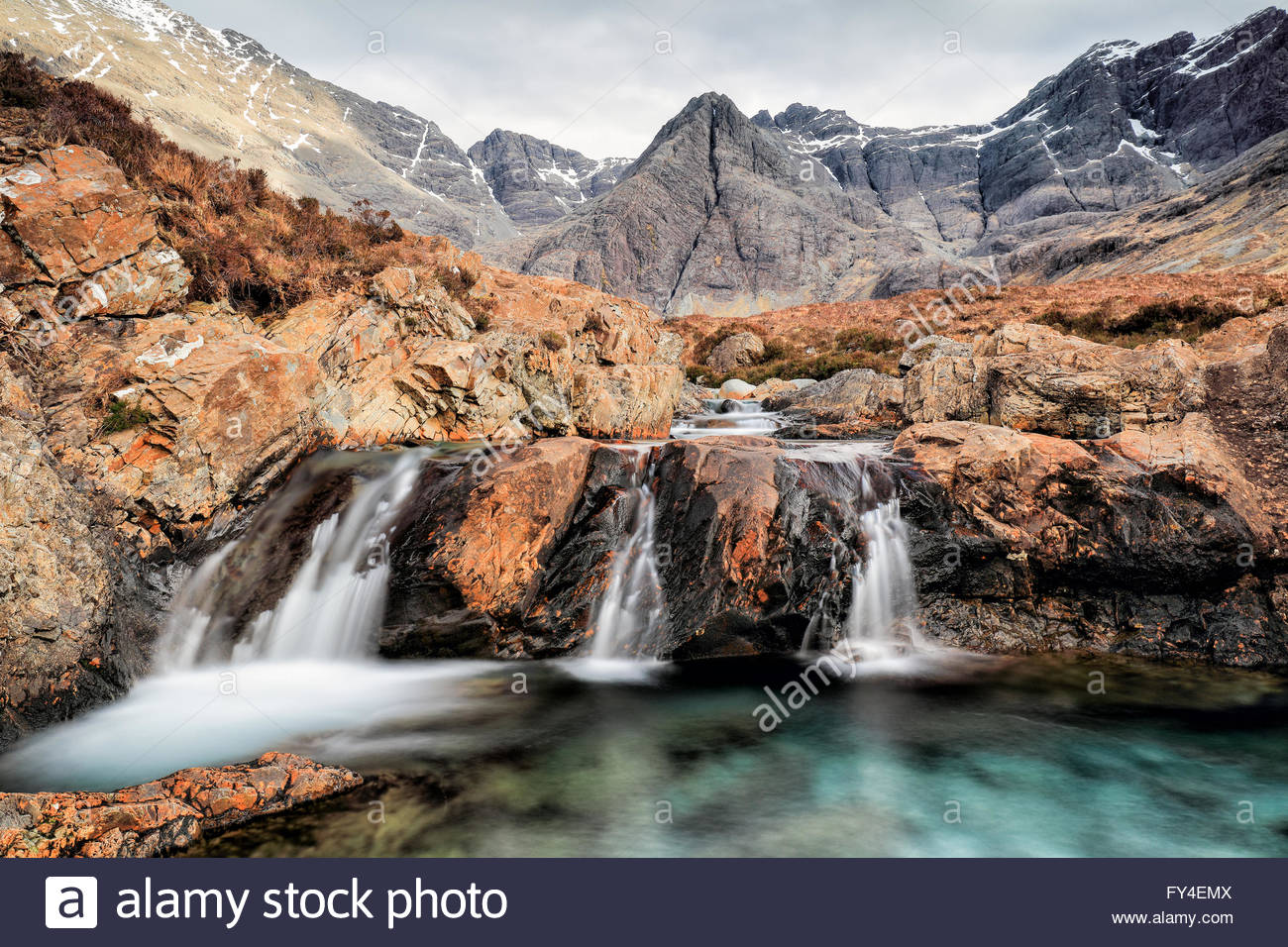 The beautiful clear turquoise water of the Fairy Pools and the Black Cuilin mountain scenery from the Isle of Skye. - Stock Image