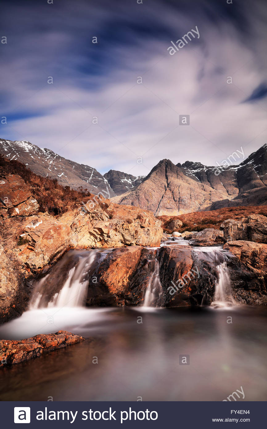 133 second long exposure of the magnificent Fairy Pools and mountain scenery from the Isle of Skye. - Stock Image