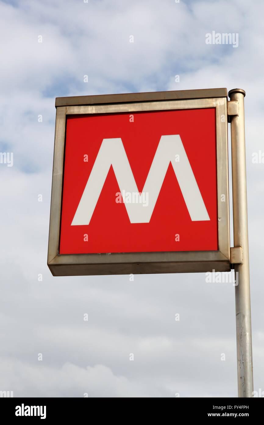 Red metro sign in Milan, Italy - Stock Image