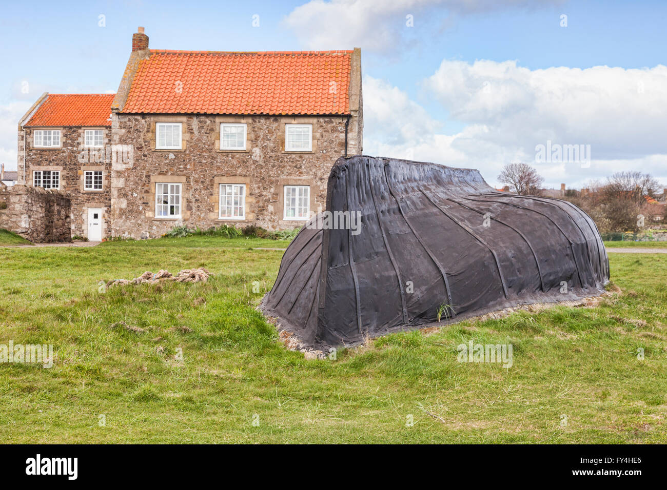 Upside down boat used as a shed, Lindisfarne, Northumberland, England, UK - Stock Image