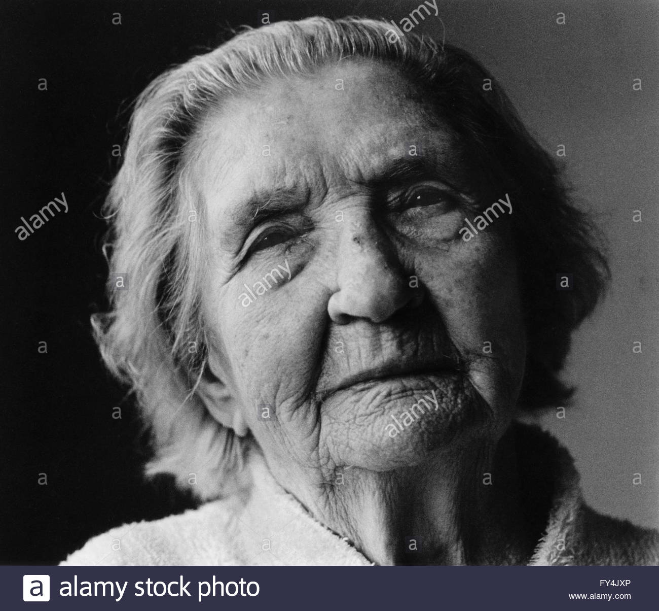 Black and white portrait of a 90 year old woman natural light side lit looking directly indyfoto