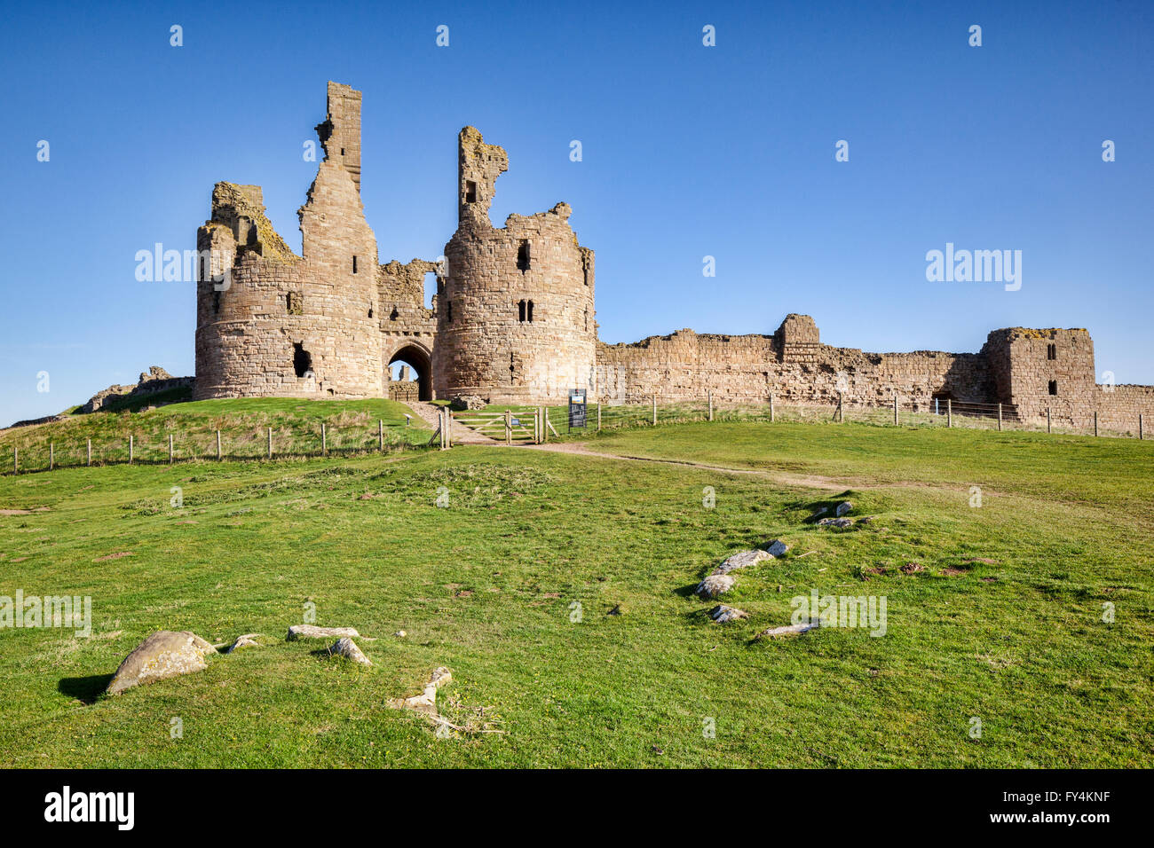 Dunstanburgh Castle on the Northumberland coast, North East England. - Stock Image