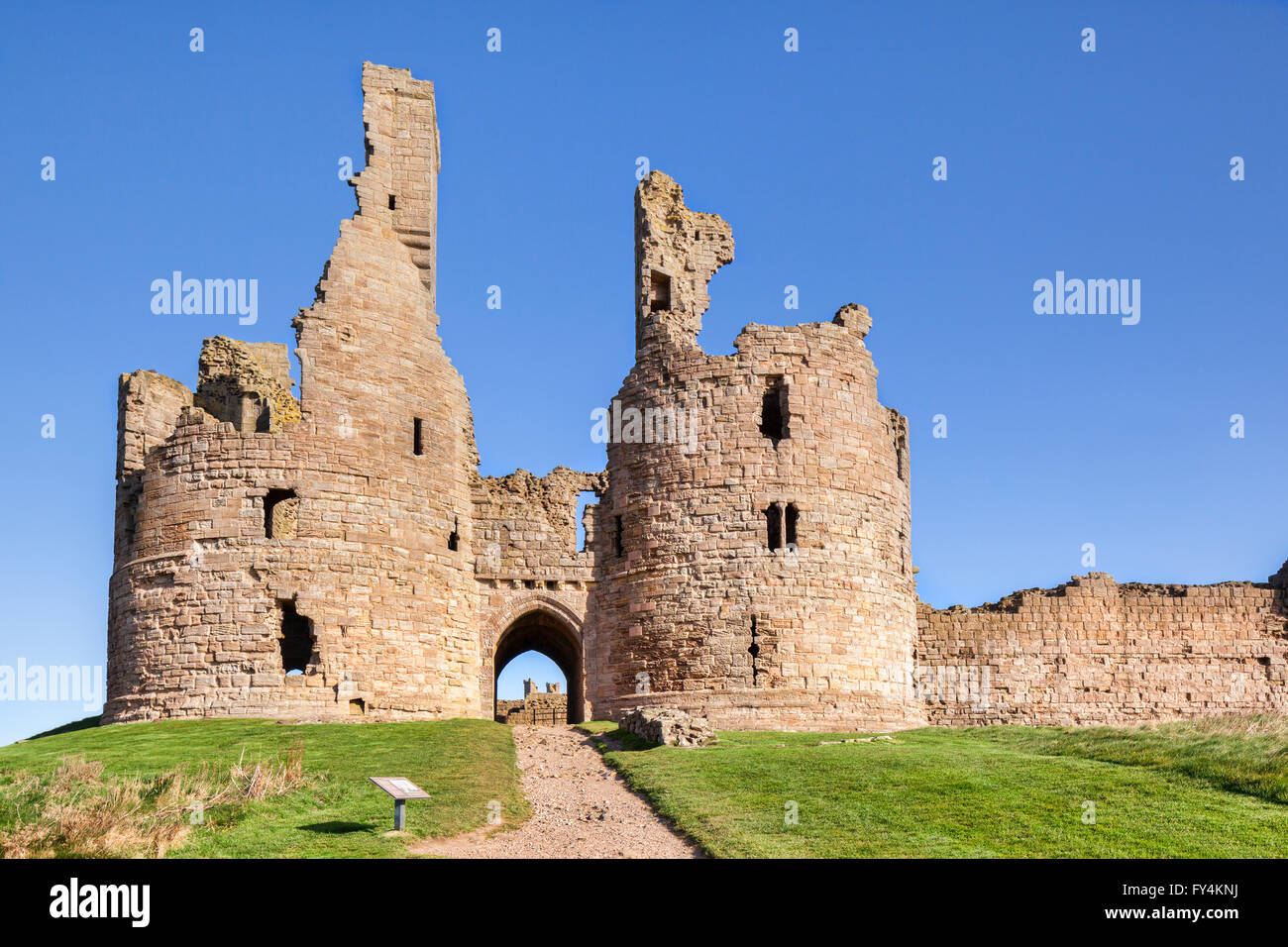 Dunstanburgh Cstle on the Northumberland coast, North East England. - Stock Image