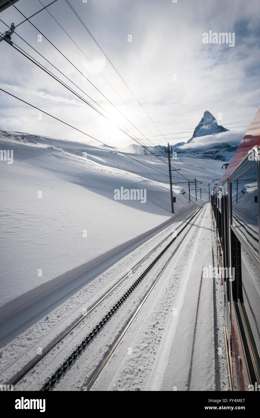 The Matterhorn is visible from a train of the famous Gornergrat railway that leads from the village of Zermatt up - Stock Image