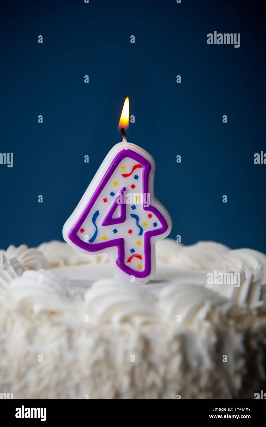 White Iced Cake On Blue Background With Candles To Celebrate Various Birthdays