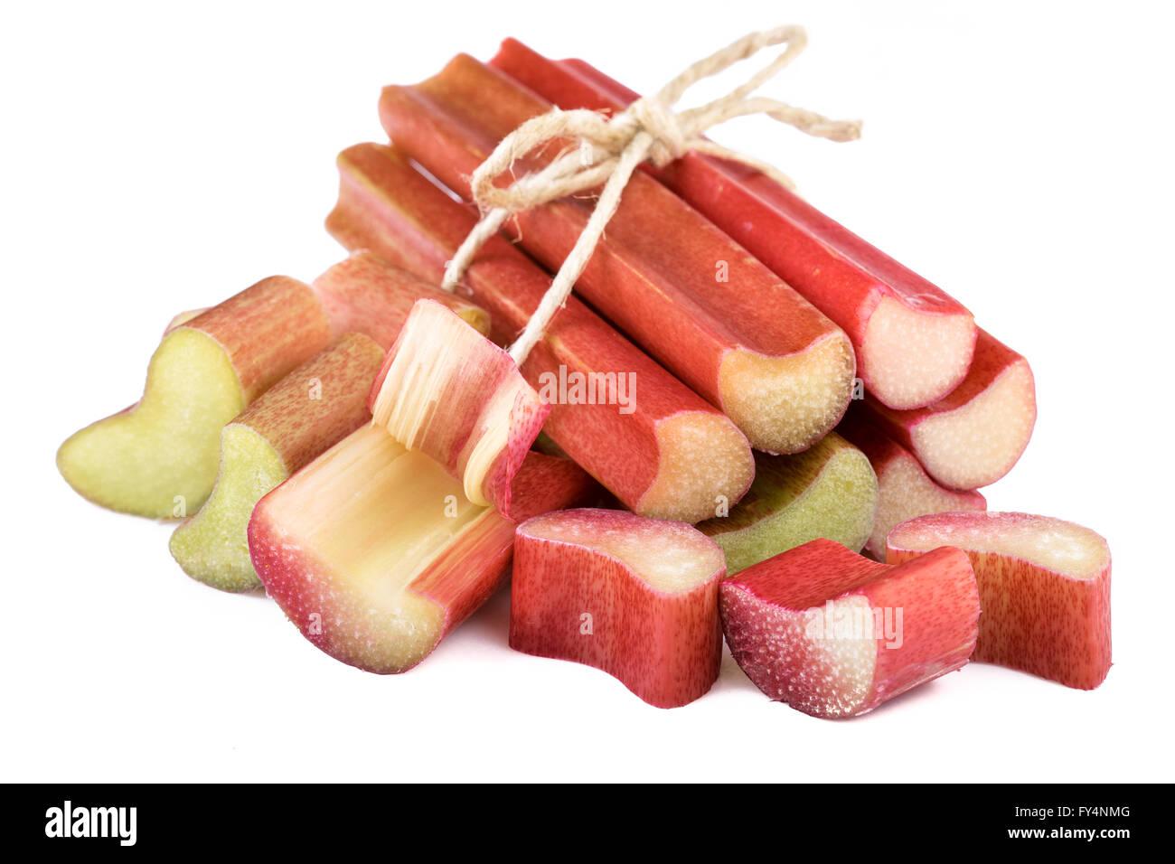 rhubarb stalks on white background - Stock Image