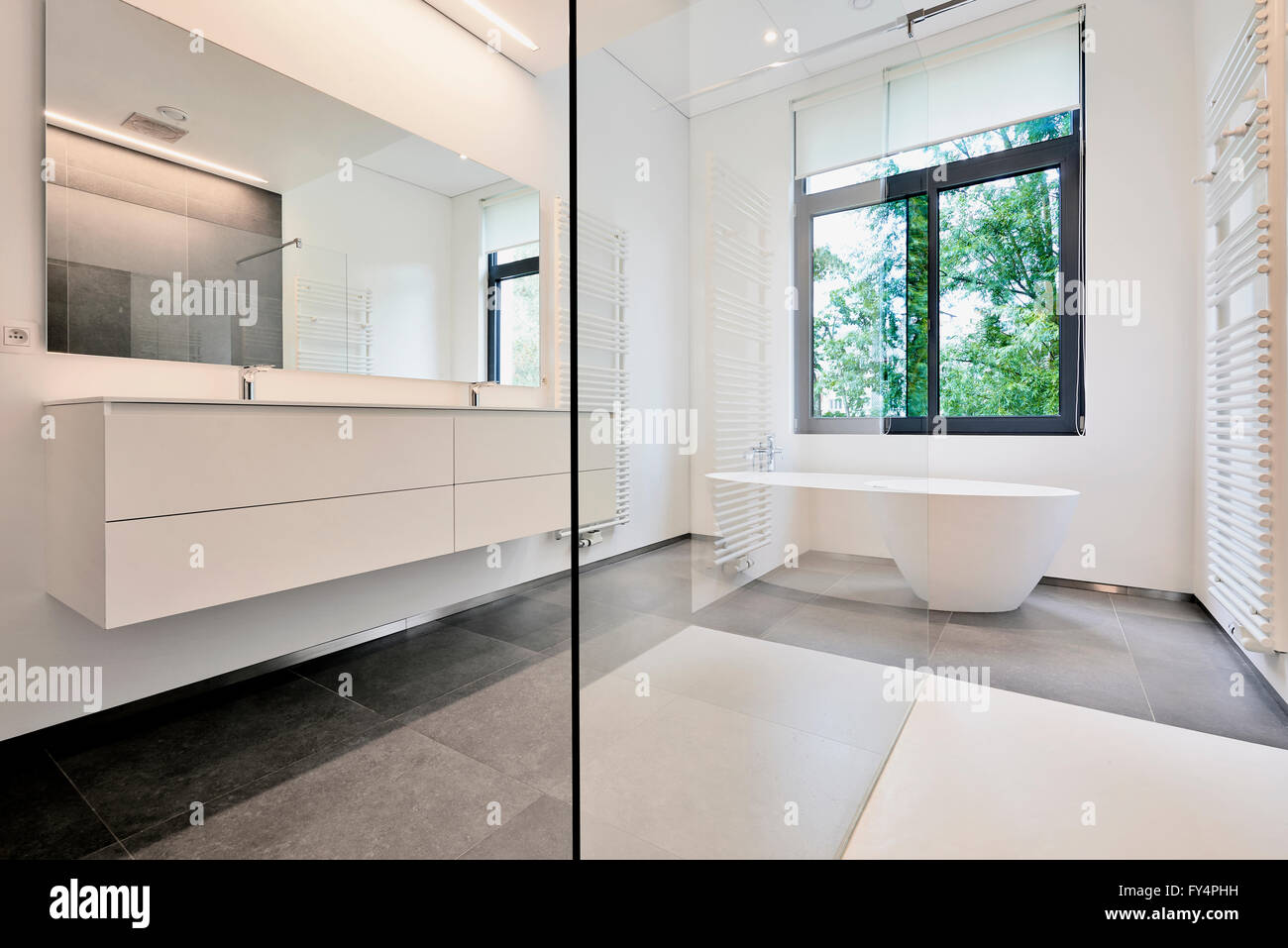 Bathtub in corian, Faucet and shower in tiled bathroom with windows ...