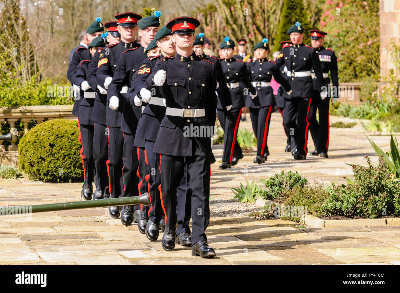 Soldiers from the 'Ulster's Gunners' in ceremonial uniform march out at Hillsborough Palace, County - Stock Image