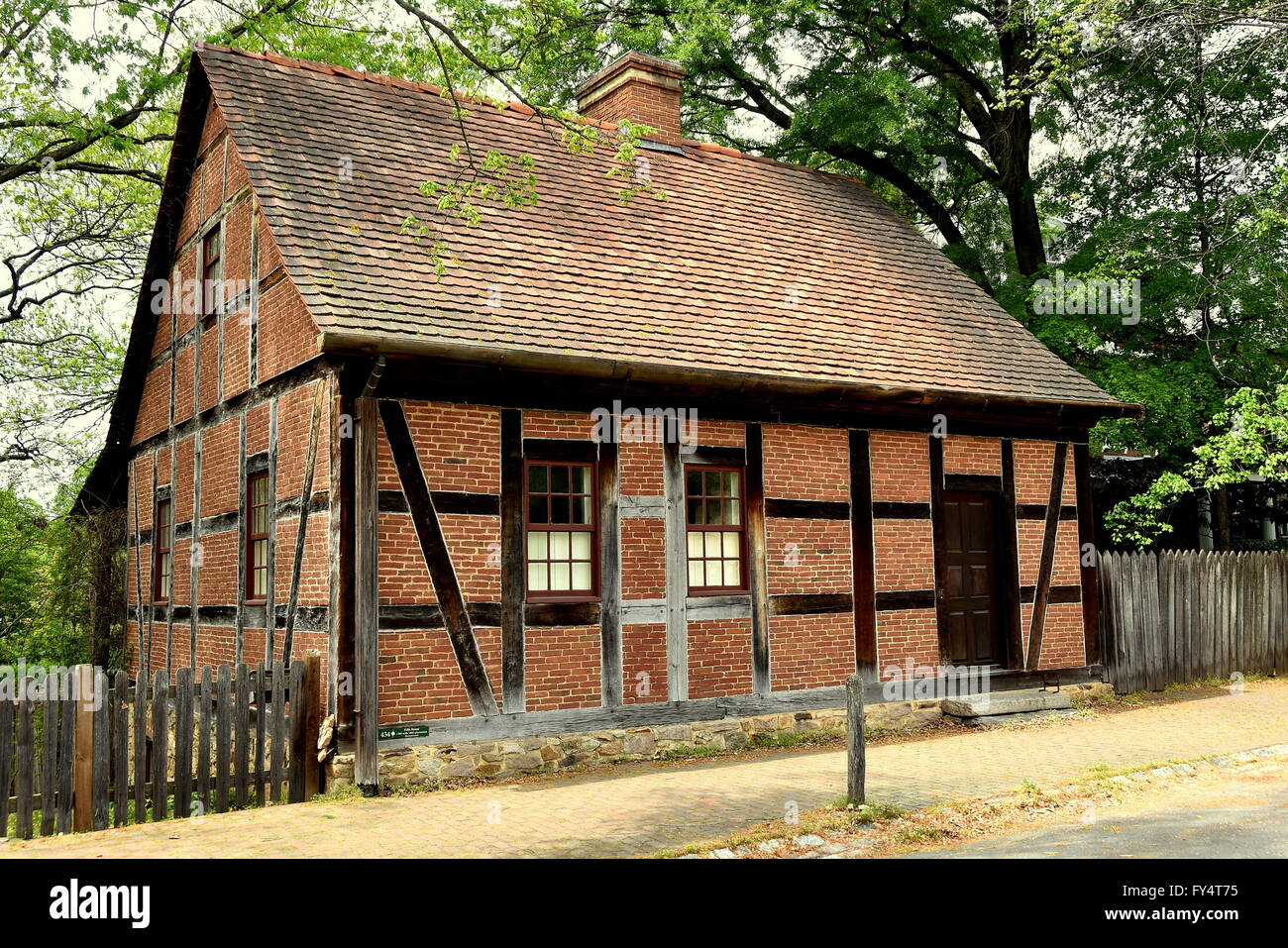 Old Salem, North Carolina:  Half-timbered and brick 1768 Moravian Fifth House with 1805 alterations on Main Street - Stock Image