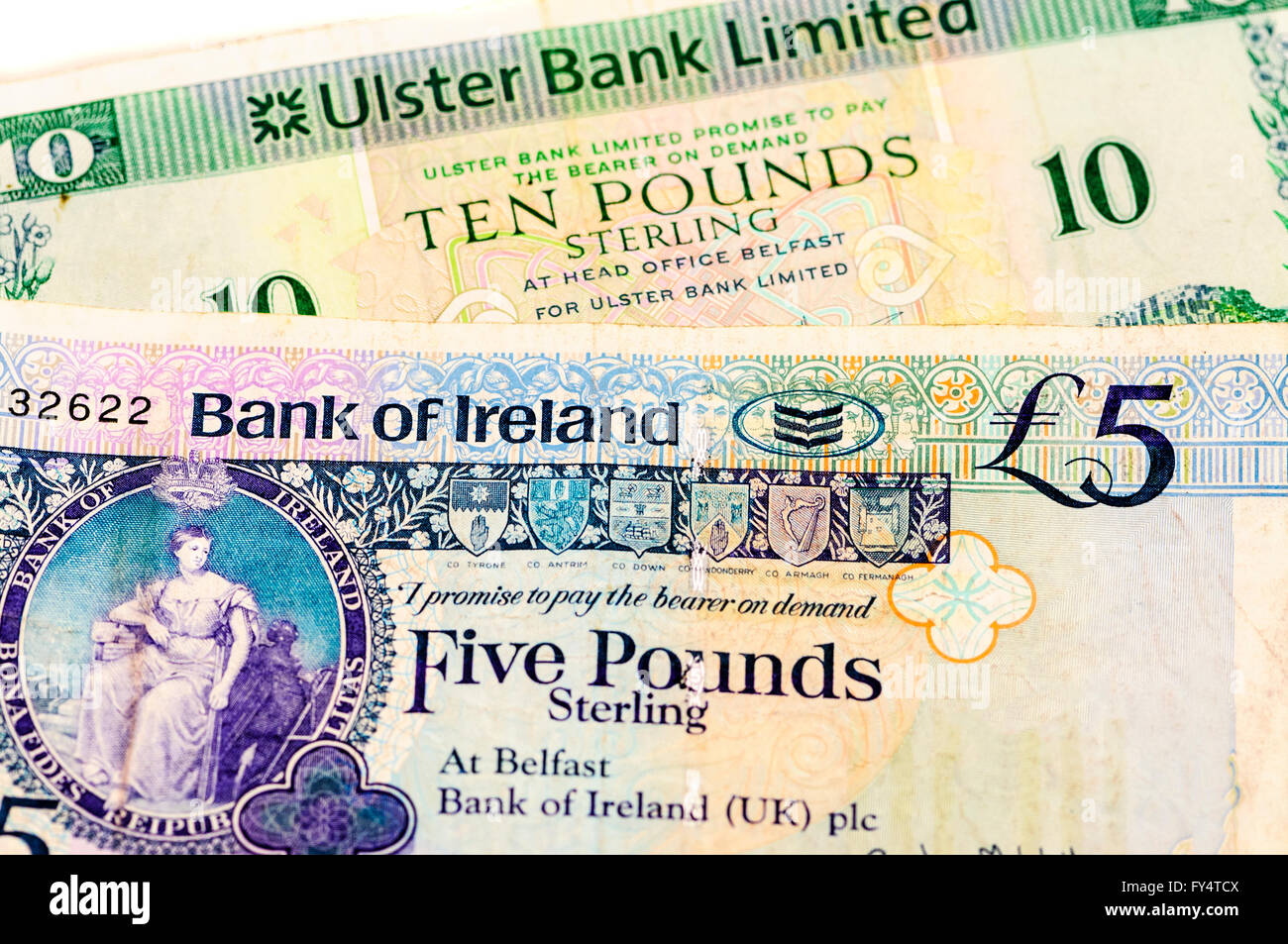 Ulster Bank and Bank of Ireland bank notes, as used in Northern Ireland. - Stock Image