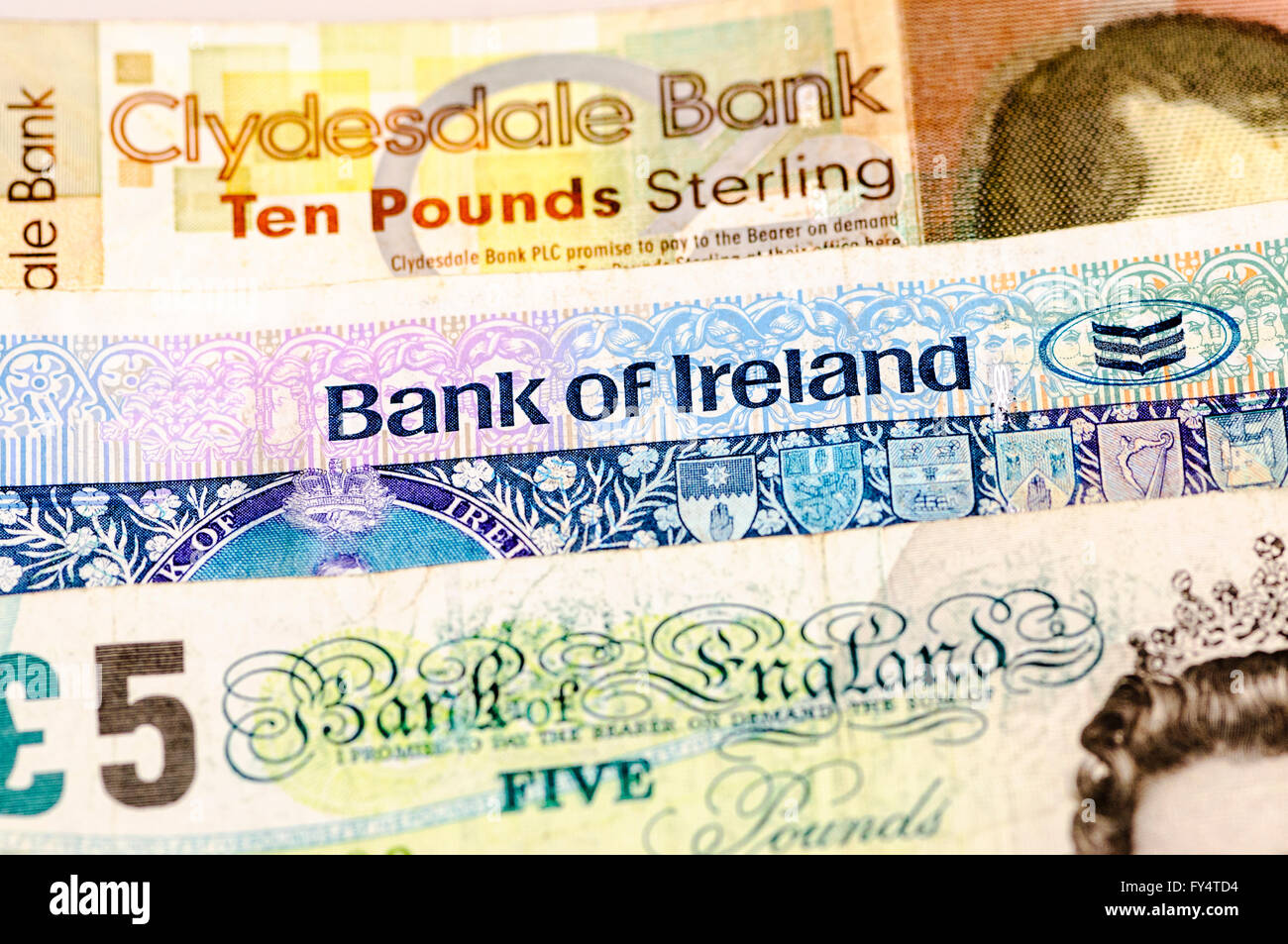 Banknotes from the Clydesdale Bank in Scotland, Bank of Ireland in Northern Ireland and the Bank of England, all Stock Photo