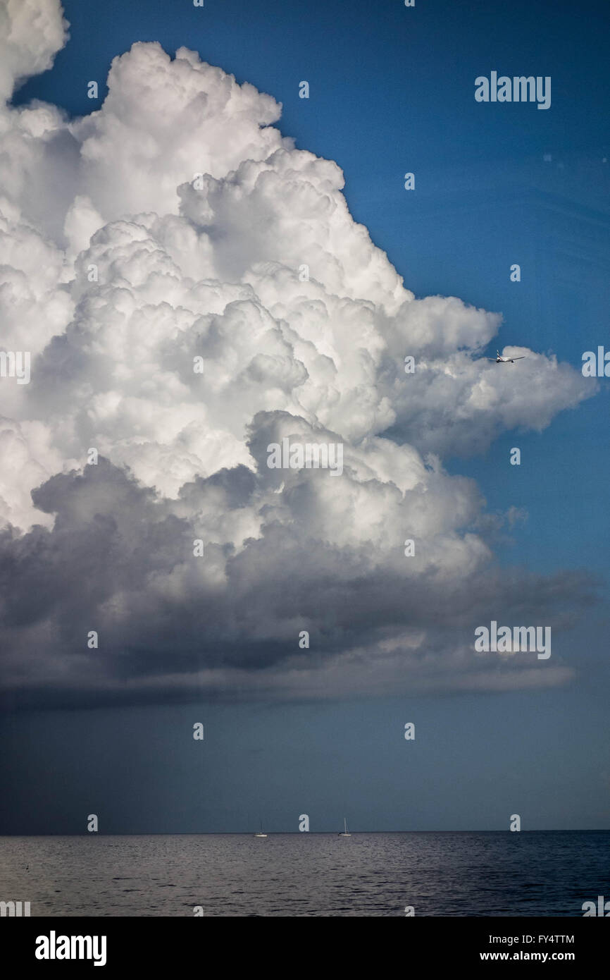 France, Nice. Boat and plane are in storm zone. Big clouds is fantastic phenomenon. - Stock Image