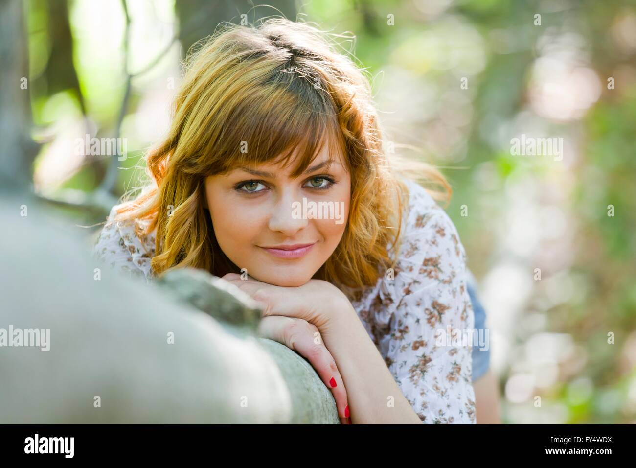 Nature-lover teen girl beautiful portrait outdoors attractive face charm personality teenage wearing apparently - Stock Image