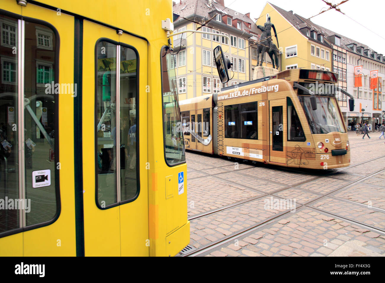Trams in the German town of Freiburg im Breisgau in the black Forest - Stock Image