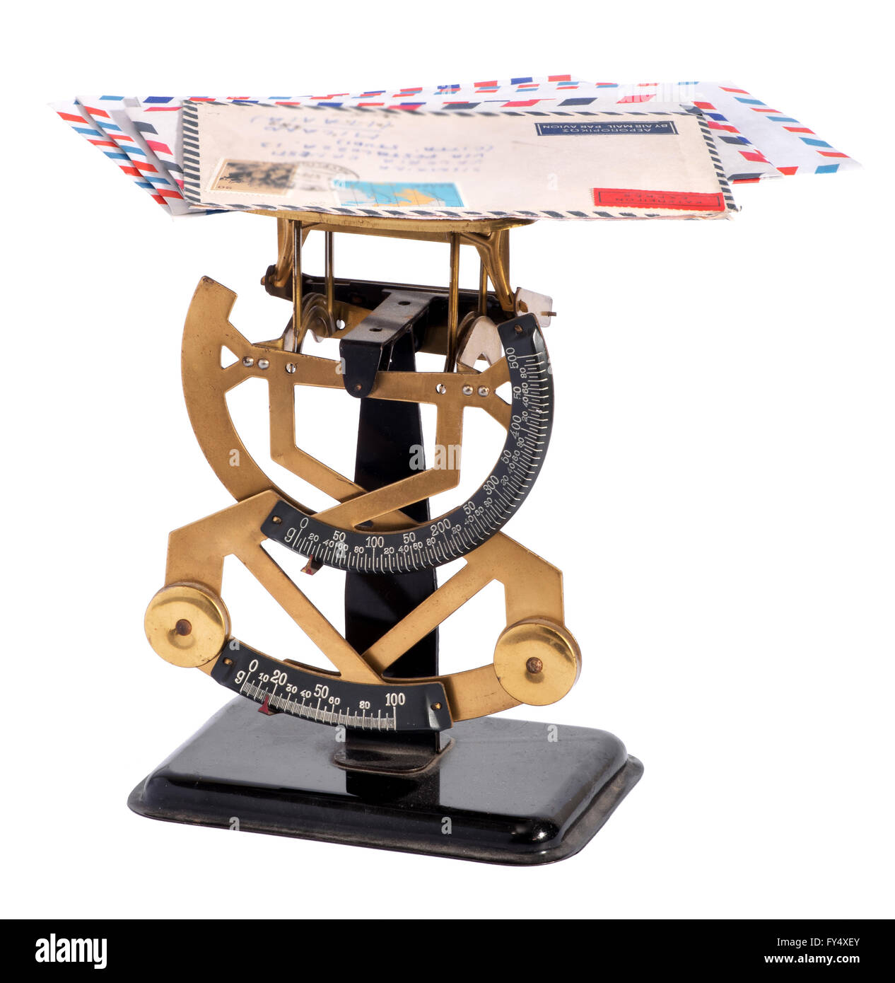 Vintage brass letter scale with a pile of letters on the top plate - Stock Image