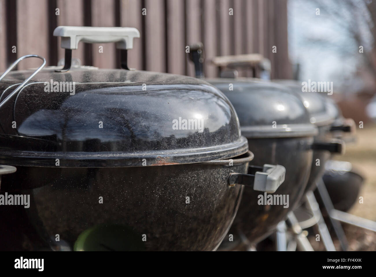 Black Barbecue Grills in a Row - Stock Image