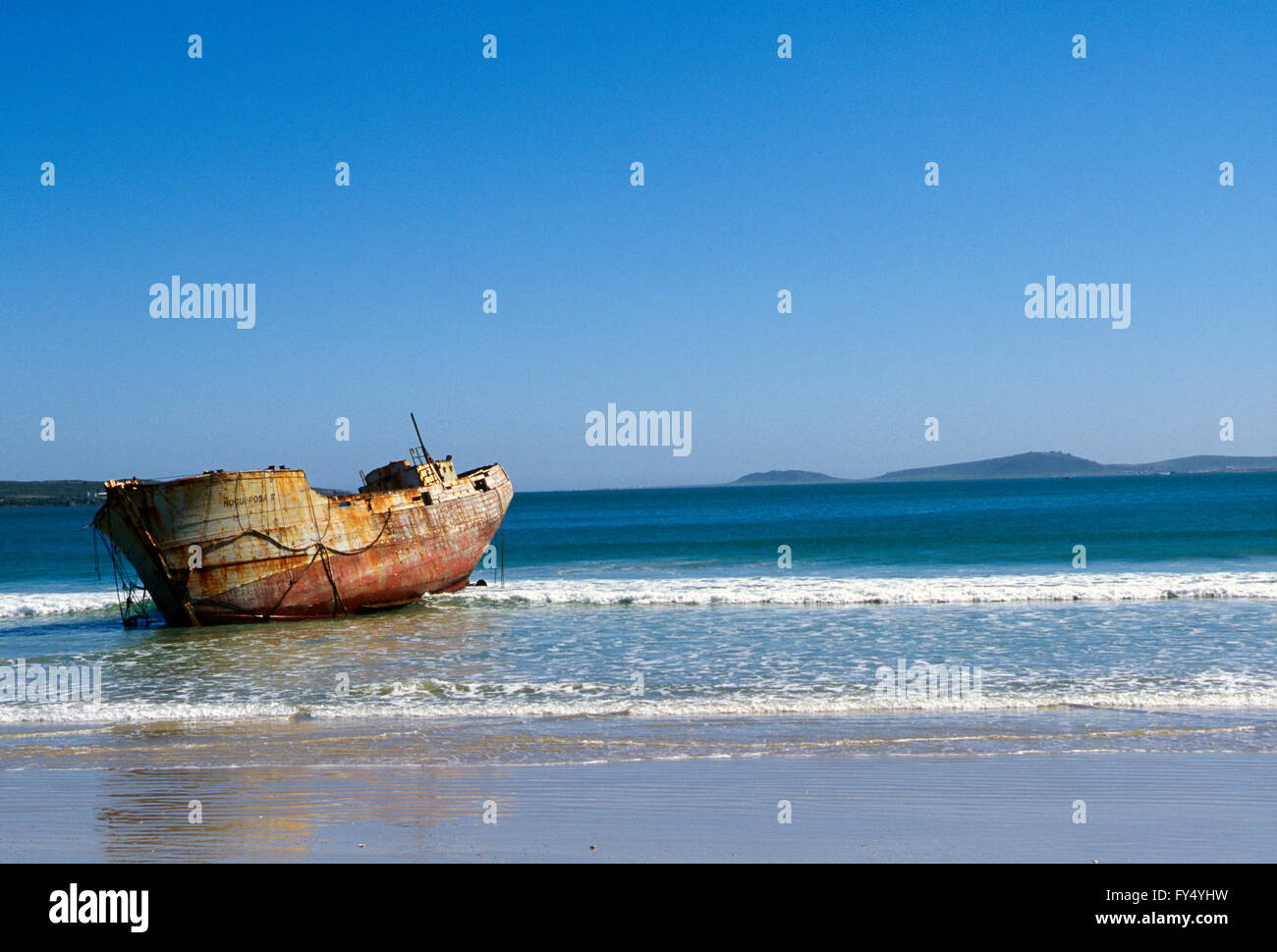 Old abandoned shipwreck; Cape Town beach; Cape Peninsula; South Africa - Stock Image