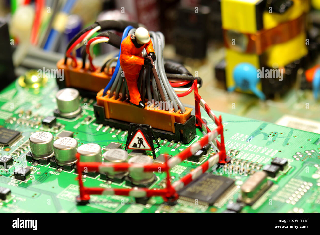 Cool Miniature Construction Worker Wiring Circuit Board Stock Photo Wiring Digital Resources Bemuashebarightsorg