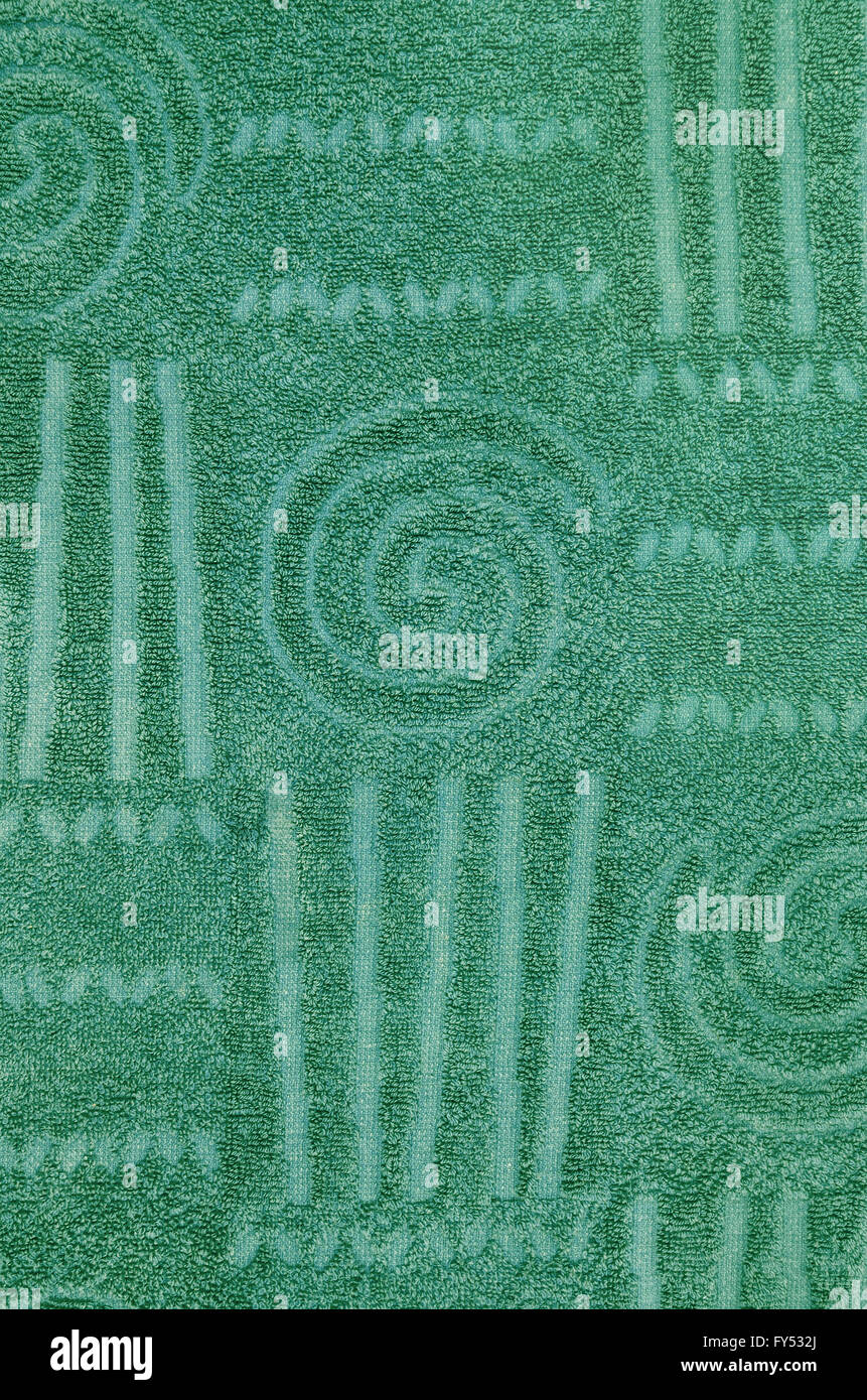 close up of a  green terry towel with geometrical and spiral pattern, vertical, - Stock Image