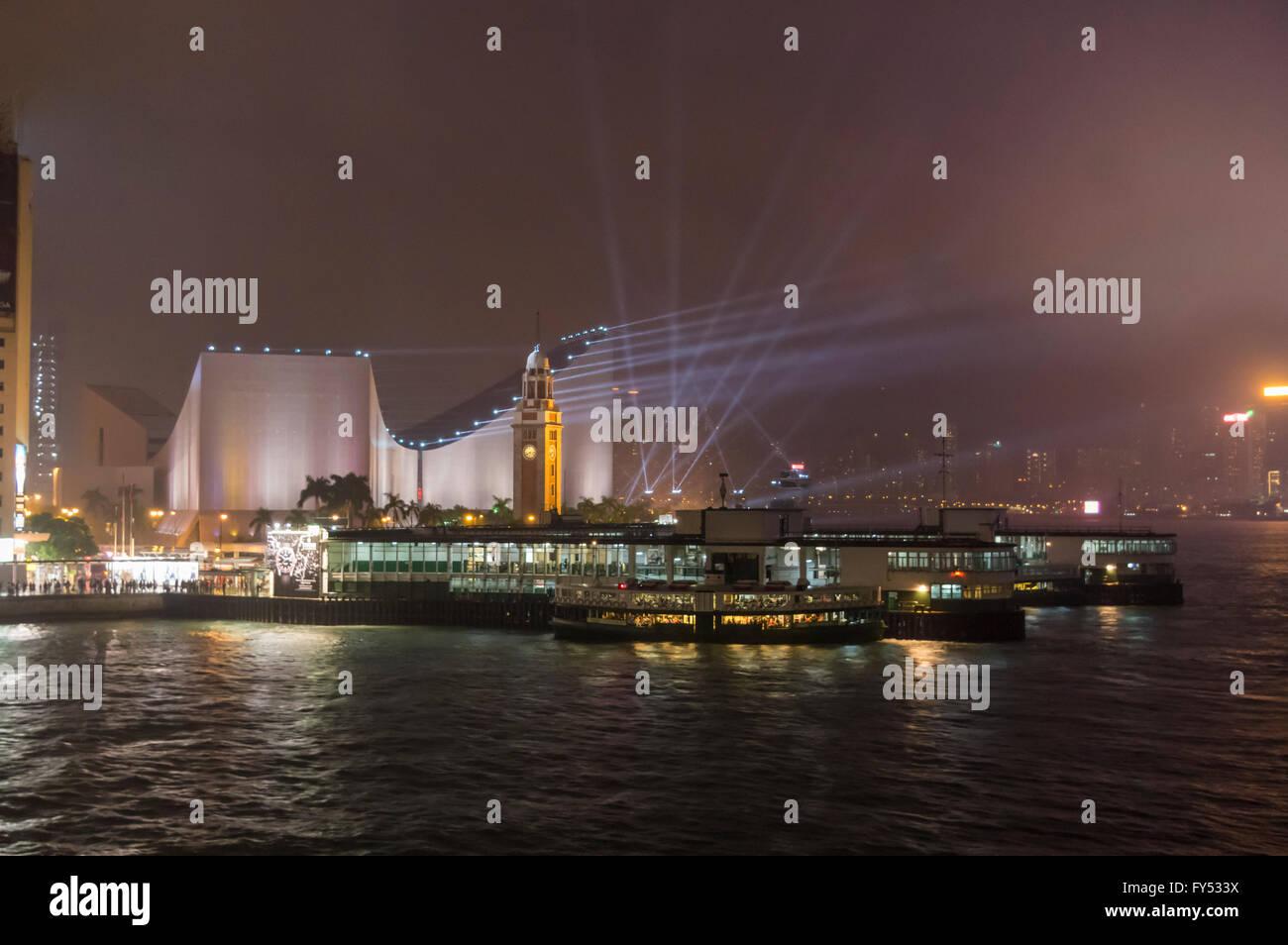 The Star Ferry Terminal, Tsim Sha Tsui Clock Tower, and Hong Kong Cultural Centre at night. Kowloon, Hong Kong. - Stock Image