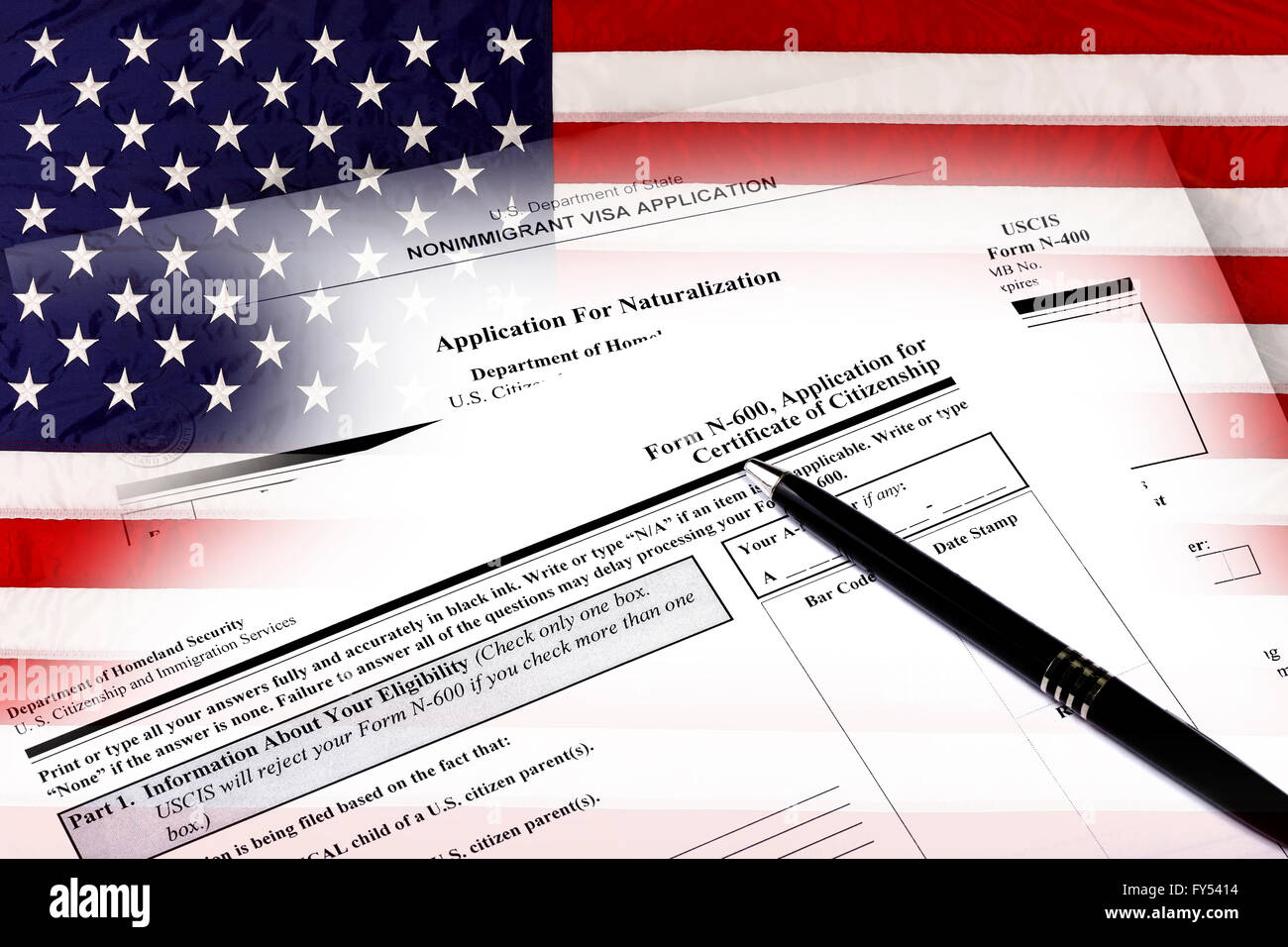 Immigration naturalization application and USA flag concept of citizenship and American patriotism. - Stock Image