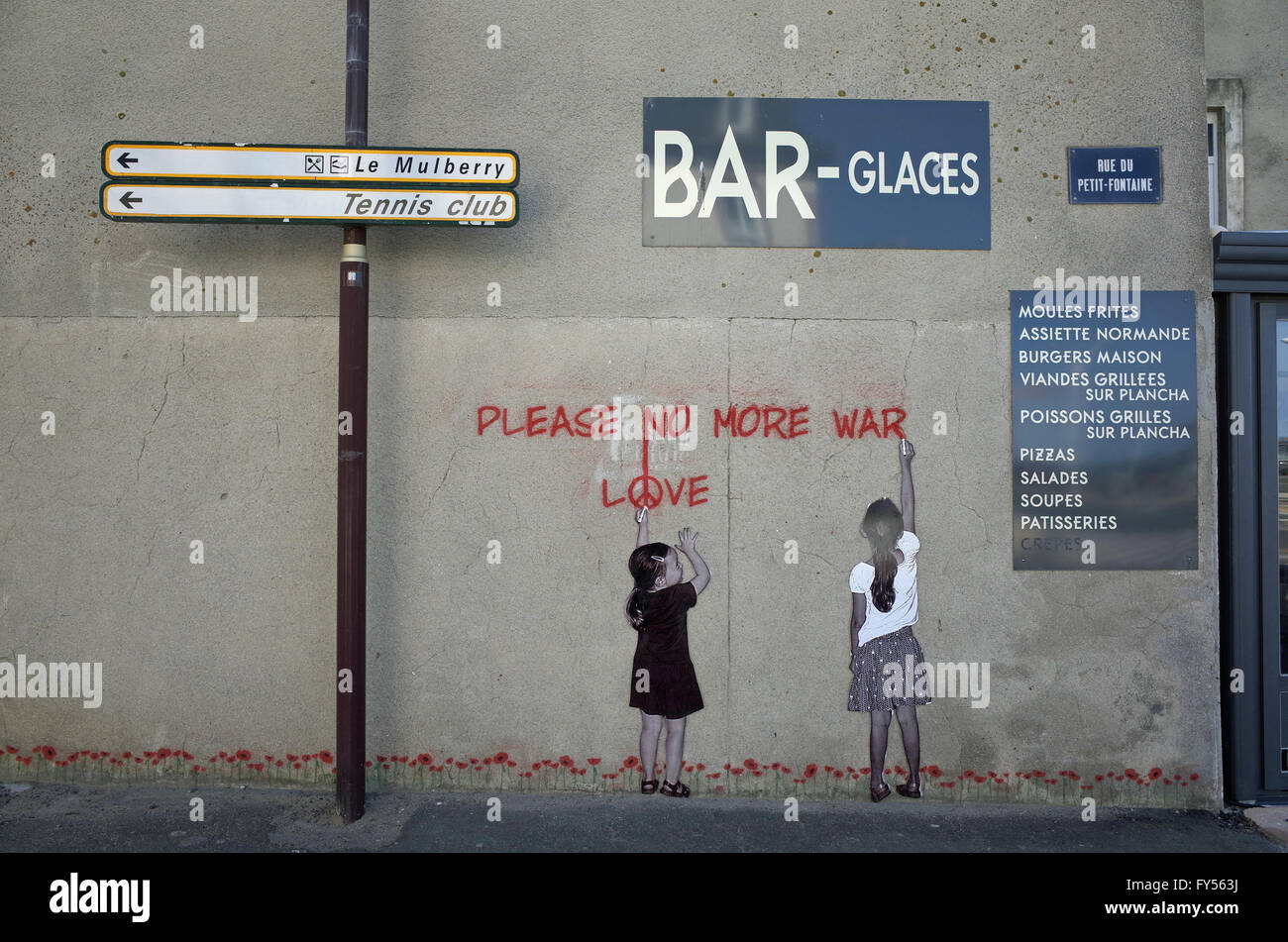 Wall painting of children painting 'Please No More War - Love' on wall in rural France - Stock Image
