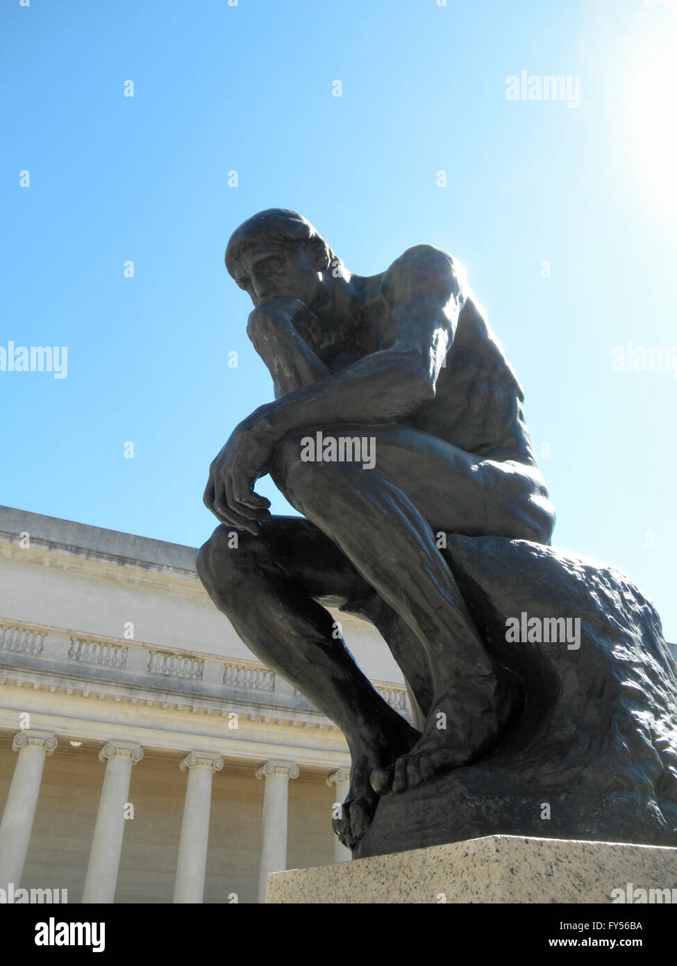 Side front profile of the masterpiece the Thinker by Rodin - The Thinker at the entrance of the Palace of the Legion - Stock Image