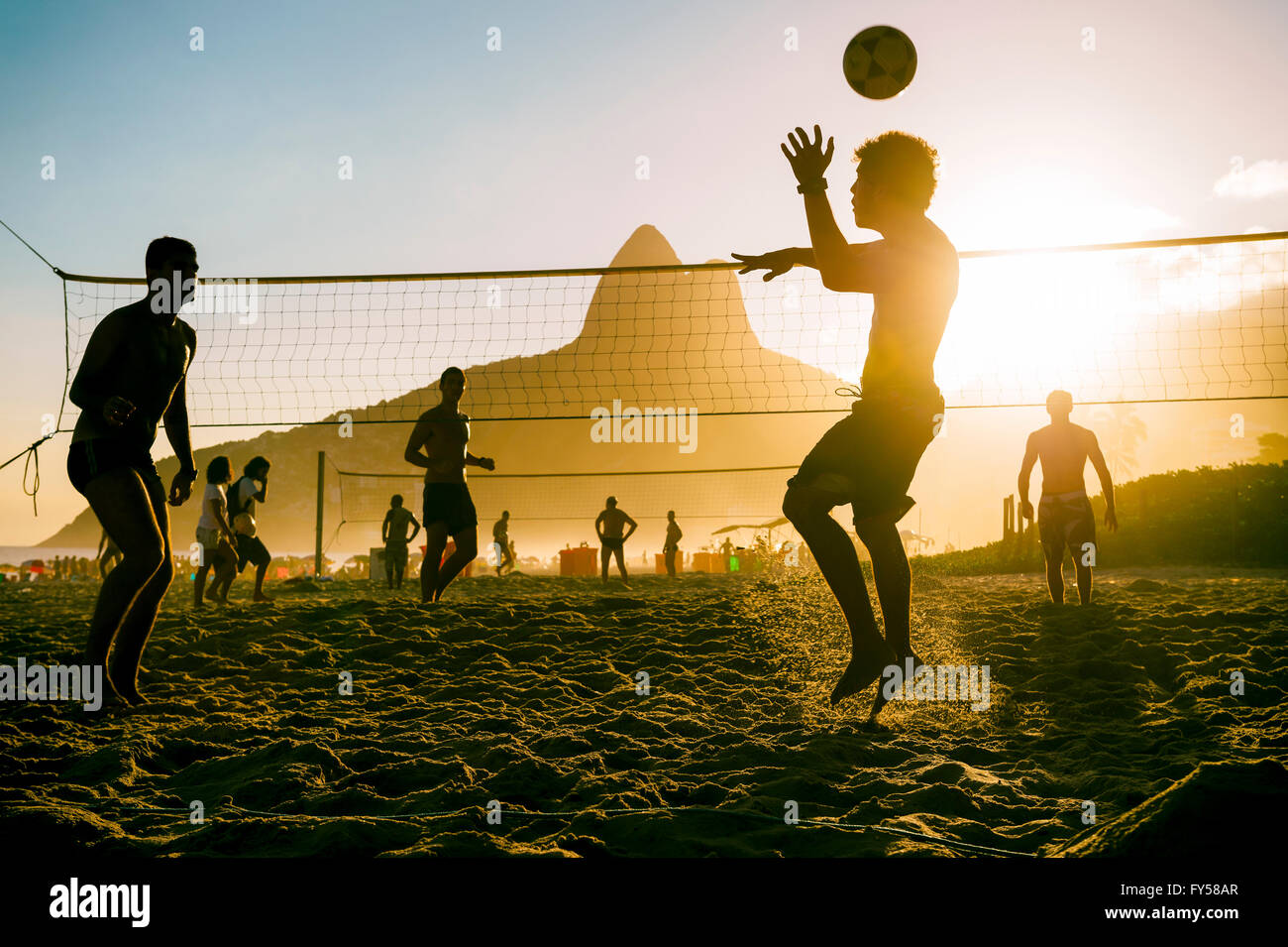 RIO DE JANEIRO - MARCH 27, 2016: Brazilians play beach futevolei (footvolley), combining football (soccer) and volleyball. - Stock Image