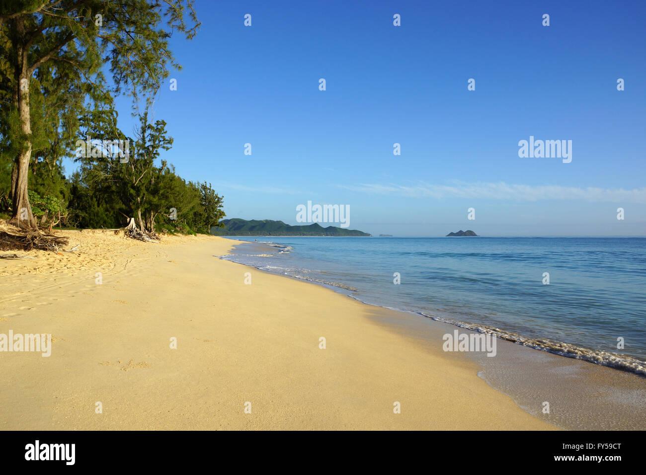 Gentle wave lap on Waimanalo Beach looking towards Mokulua islands on a nice day Oahu, Hawaii. - Stock Image