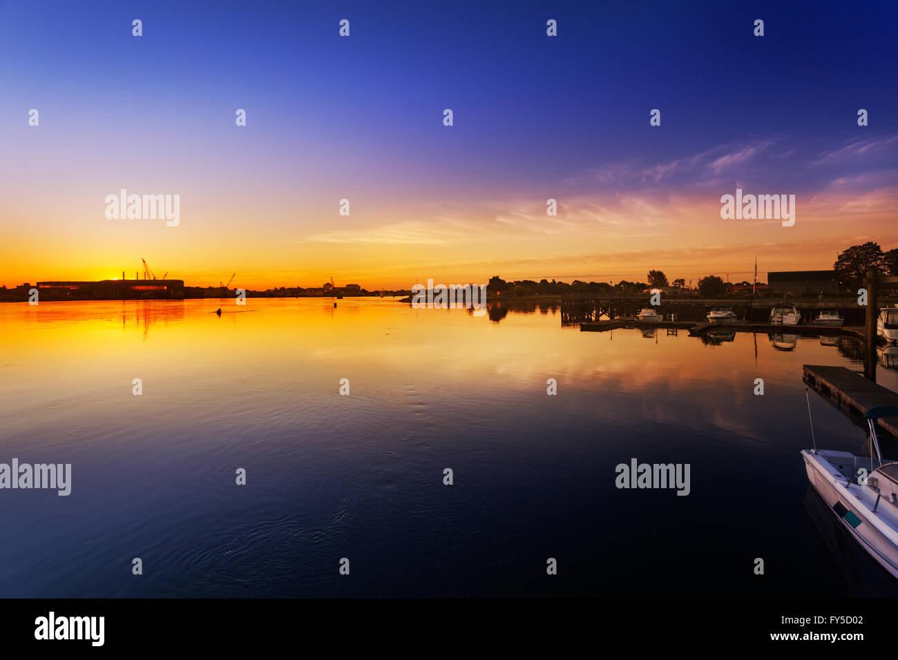 Sun rising behind Navy Yard buildings Stock Photo