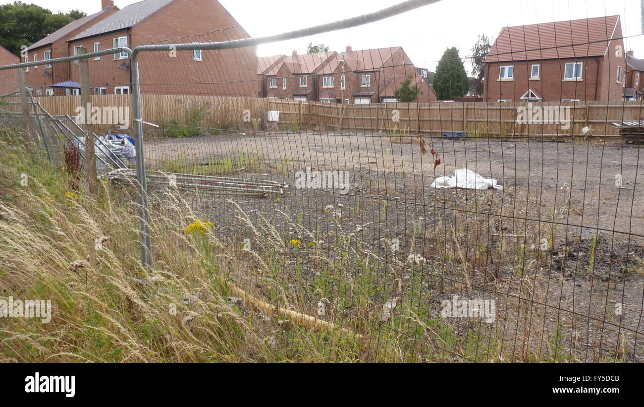 Brownfield site cleared wasteland fenced off - Stock Image