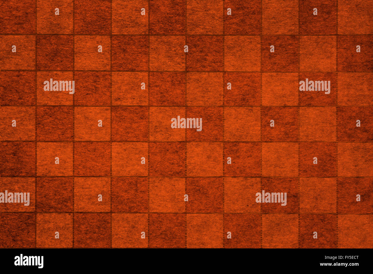 Brown grungy chessboard background with complex texture - Stock Image