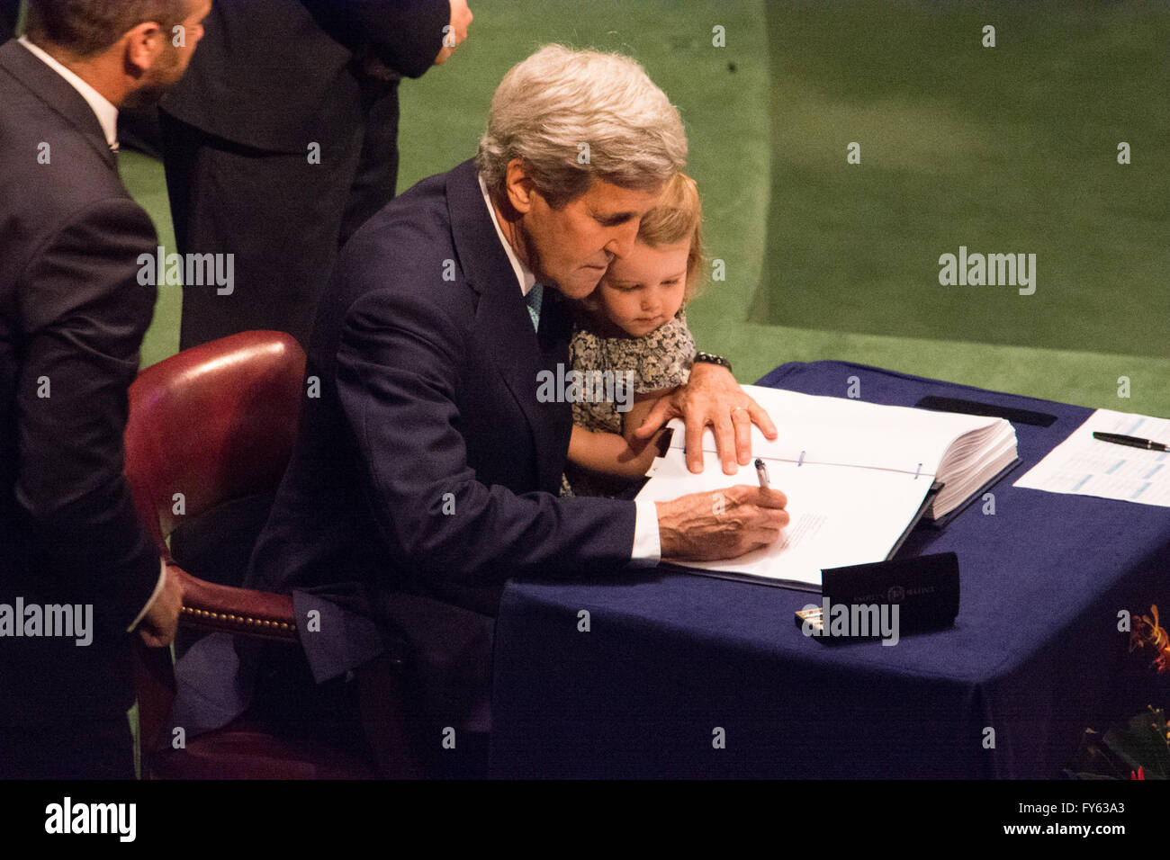 New York, USA. 22nd April 2016. US Secretary of State John Kerry holds his granddaughter as he signs the climate Stock Photo