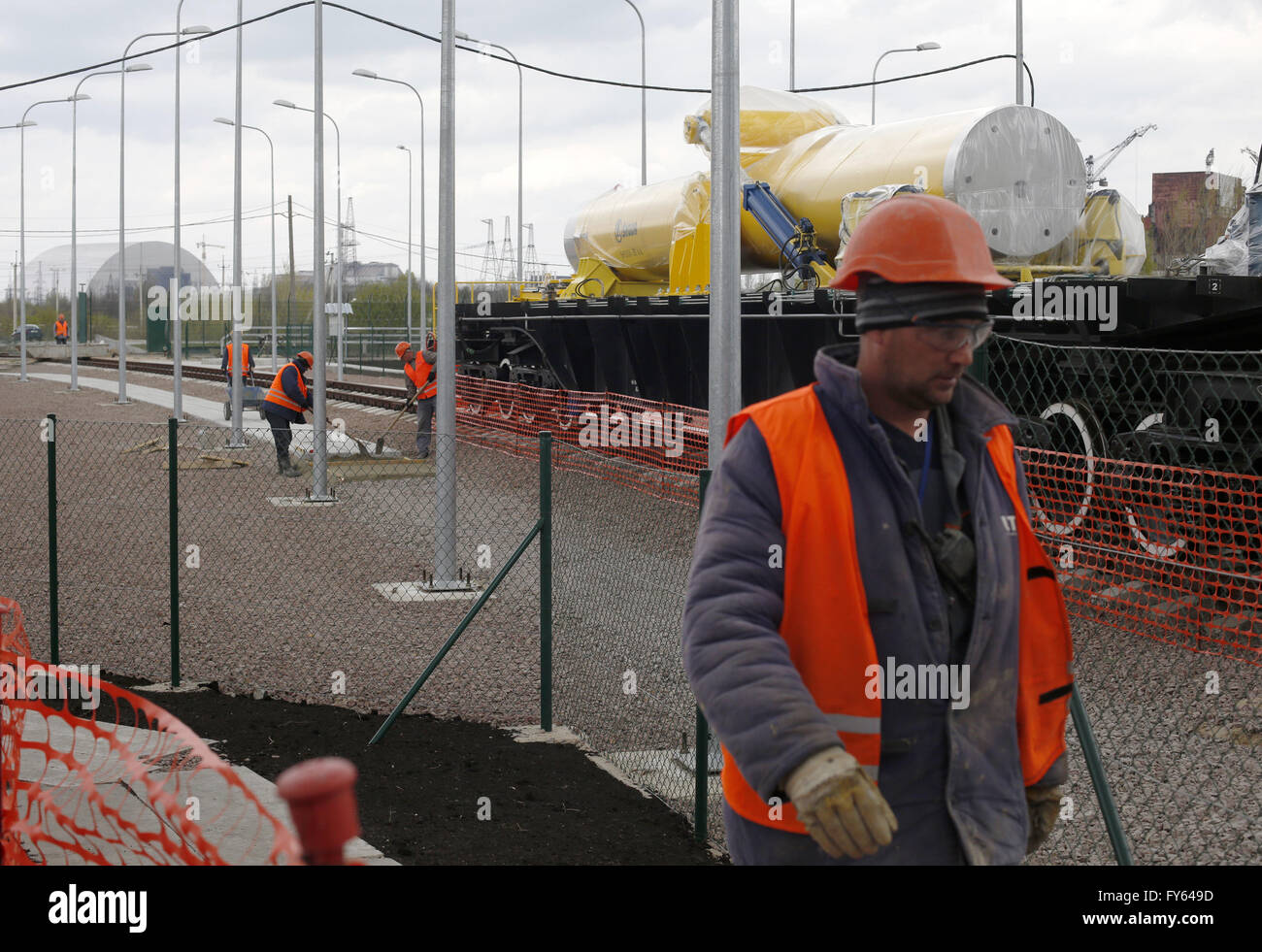 April 22, 2016 - Worker passes by the railway containers for the fulfilled nuclear fuel is seen at the nuclear-fuel - Stock Image
