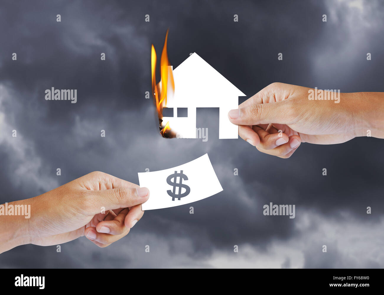 Burning house, Fire insurance - Stock Image
