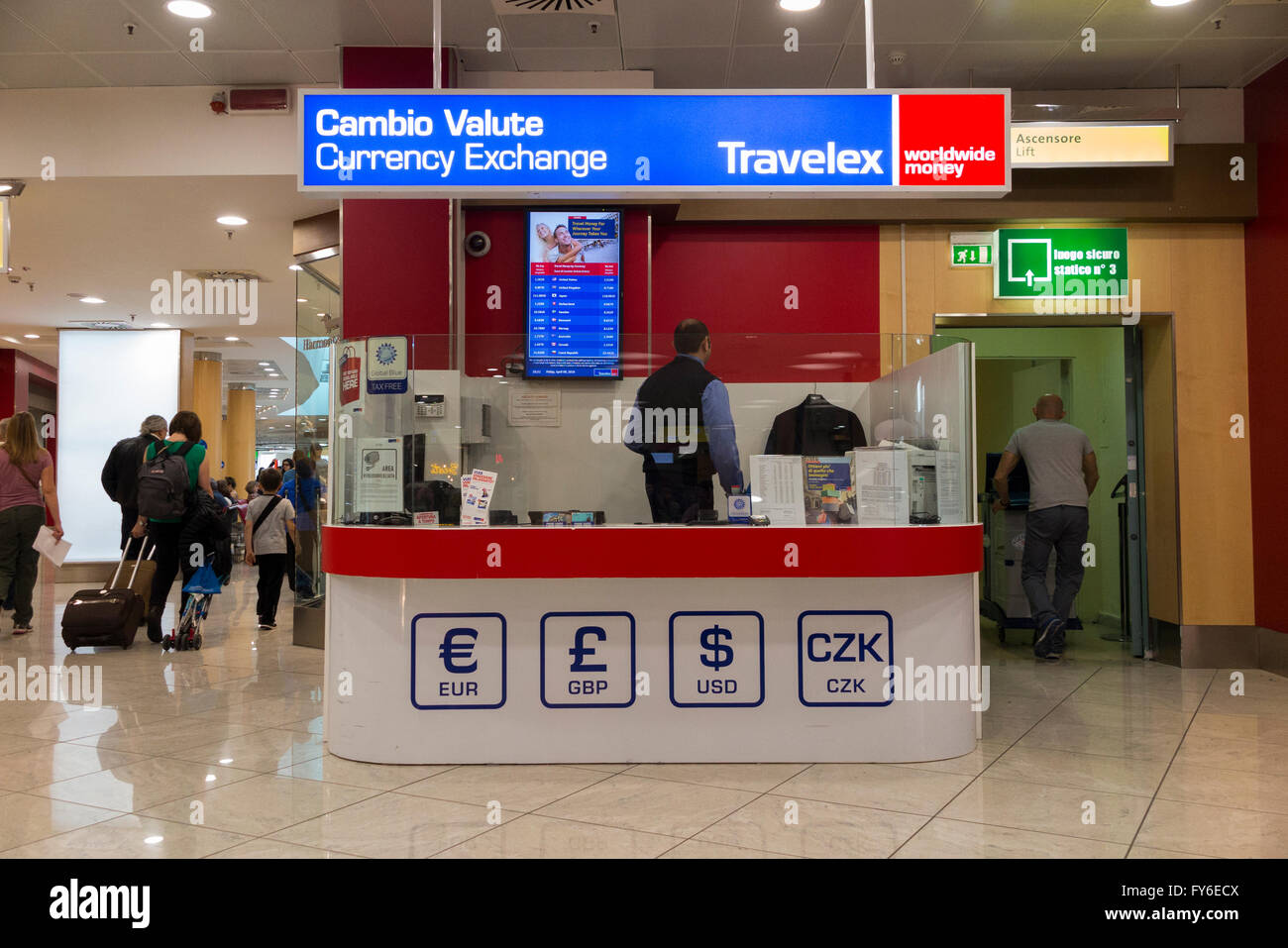 Bureau de Change office operated by Travelex at Milan Linate Airport, Italy. - Stock Image