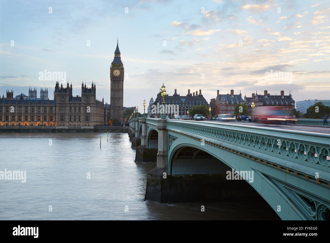 Big Ben and Palace of Westminster, traffic on bridge at dusk in London, natural light and colors - Stock Image
