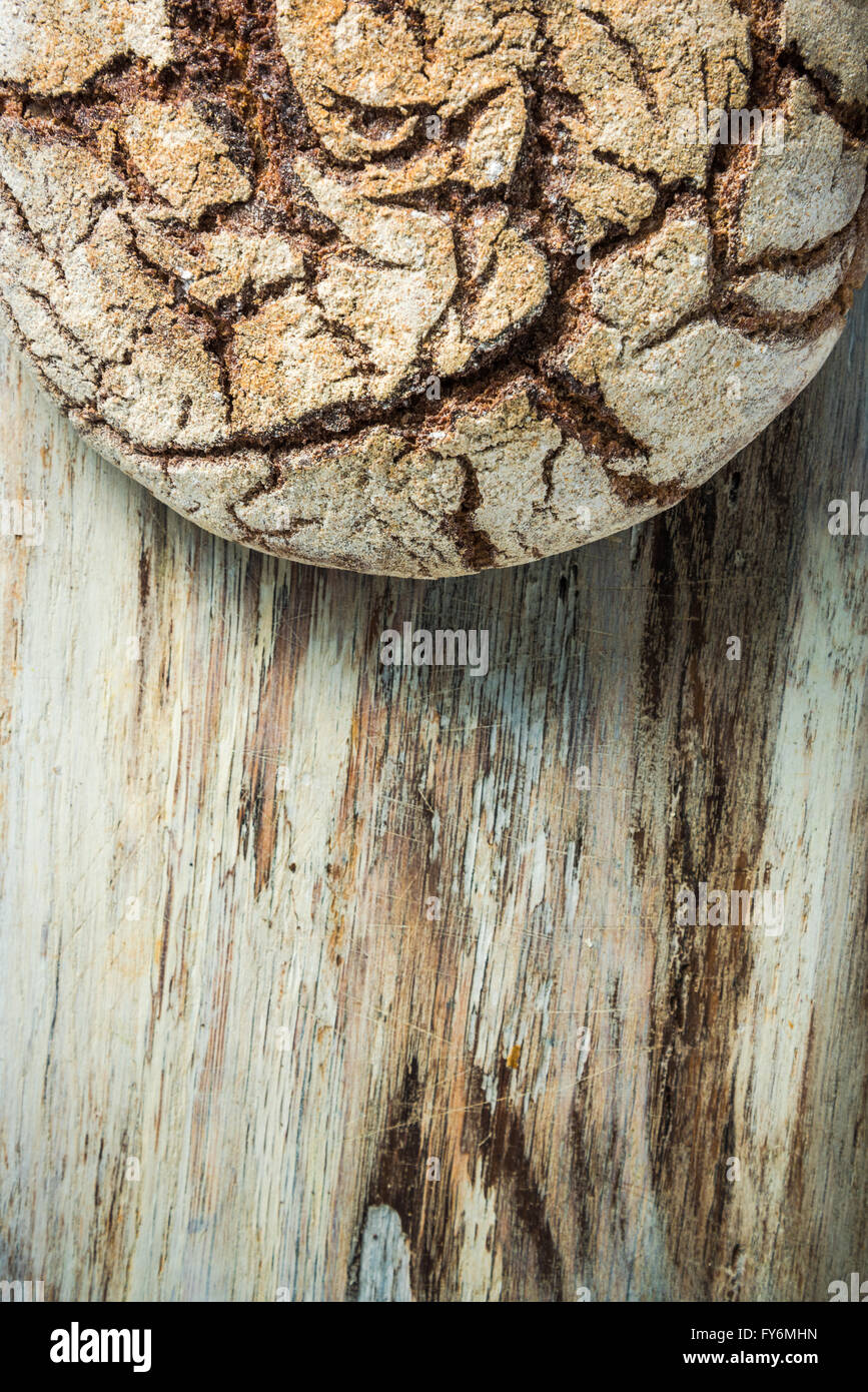 Artisan homemade bread loaf, from above on wooden board Stock Photo
