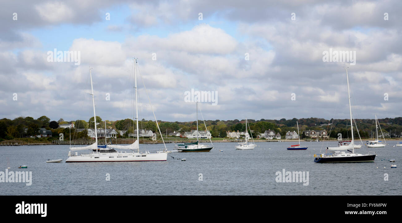 many sailboats sit anchored in the water in the harbor in Stonington Connecticut - Stock Image