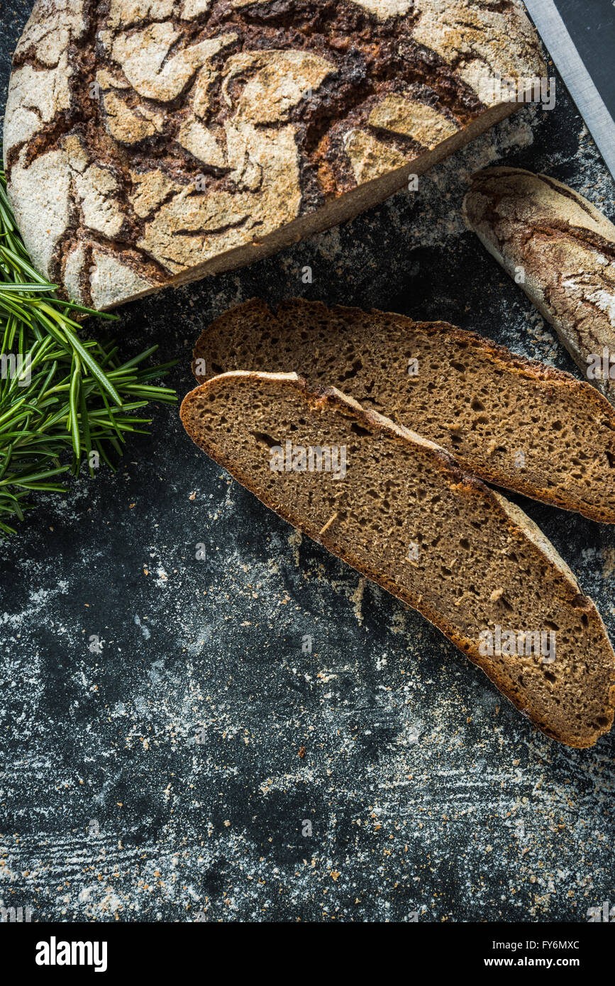 Whole loaf home baked rye bread, artisan bakery - Stock Image