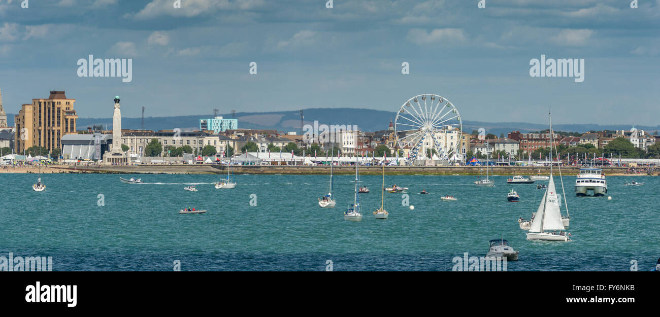 Southsea Seafront During America's Cup Portsmouth 2015 with ferris wheel and pleasure craft and South Downs in the Stock Photo