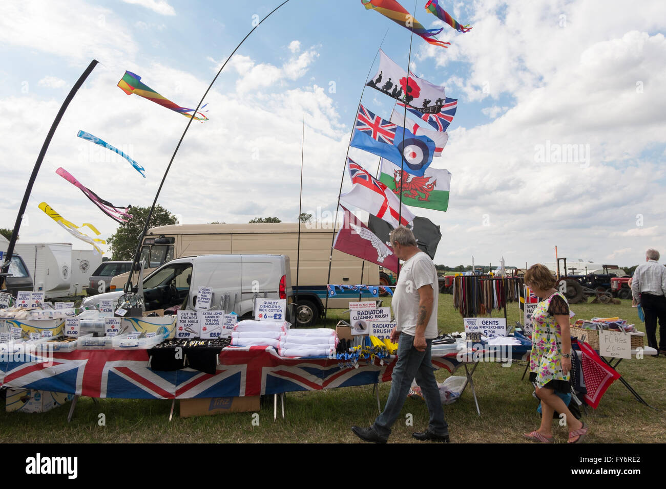 Stall selling flags, bandanas and household goods at the Fairford Steam Rally, Gloucestershire, UK - Stock Image