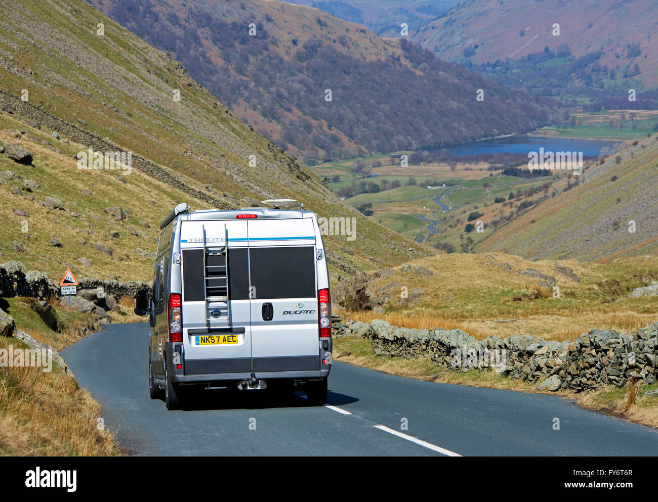 Fiat Ducato campervan on Kirkstone Pass, Lake District National Park, Cumbria, England UK - Stock Image