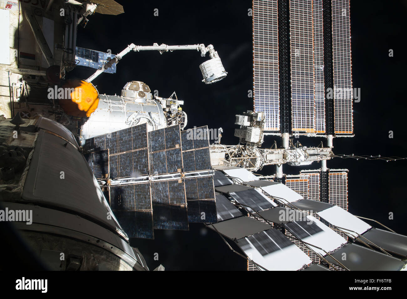 International Space Station astronauts use the robotic Canadarm2 to move the Bigelow Expandable Activity Module - Stock Image
