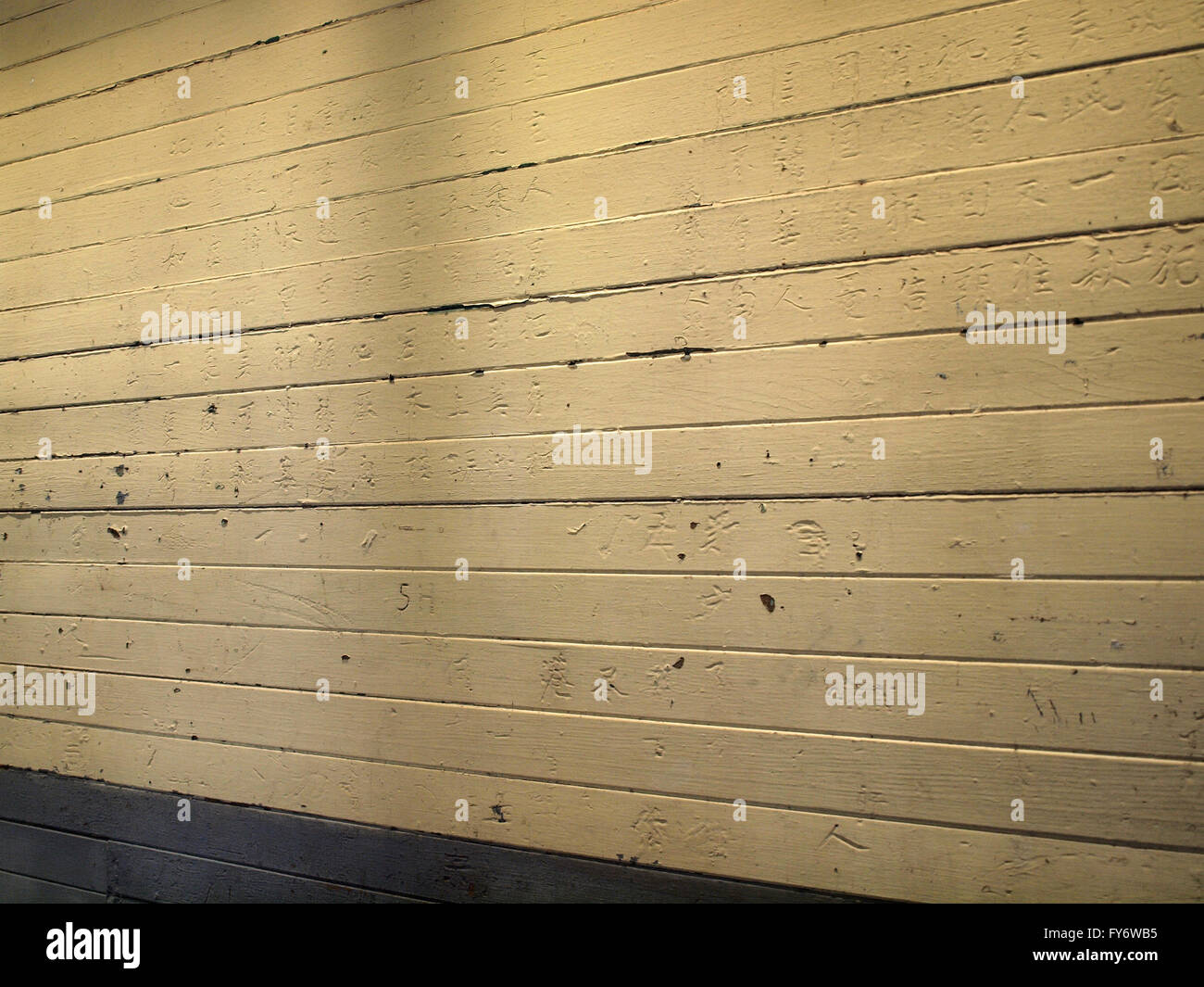 Chinese writting written on the wall on by Chinese immigrants who were detained and interrogated at Angel Island - Stock Image