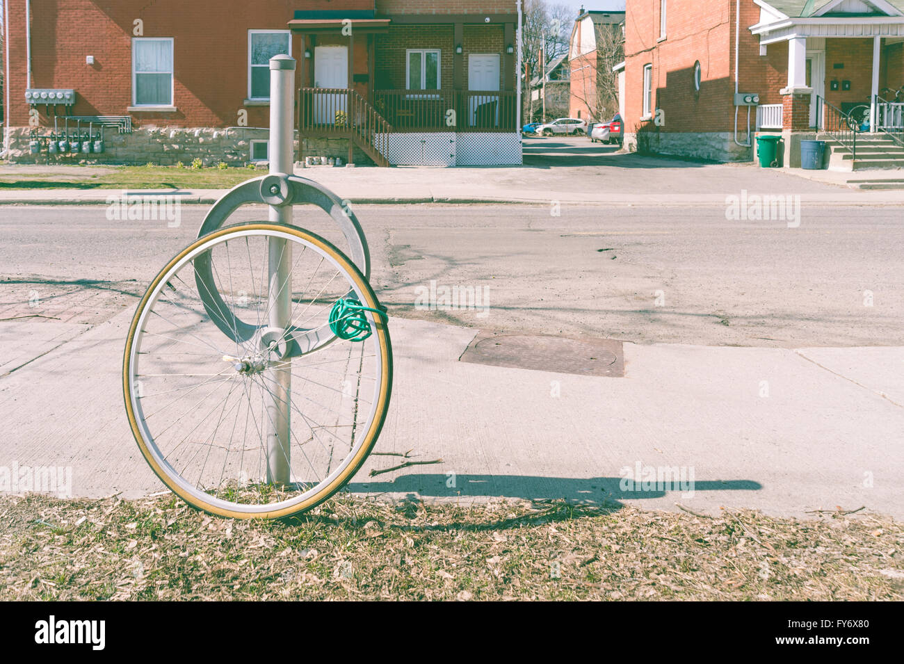 Bike theft with locked wheel in Ottawa, Canada (vintage filter) - Stock Image