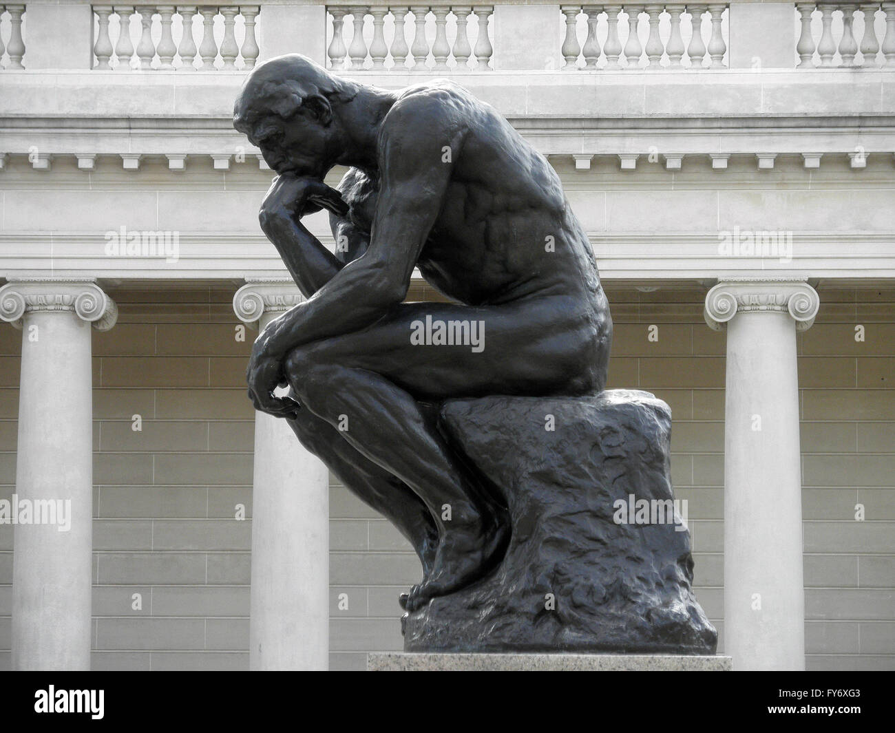 Side profile of the masterpiece the Thinker by Rodin - The Thinker at the entrance of the Palace of the Legion of - Stock Image